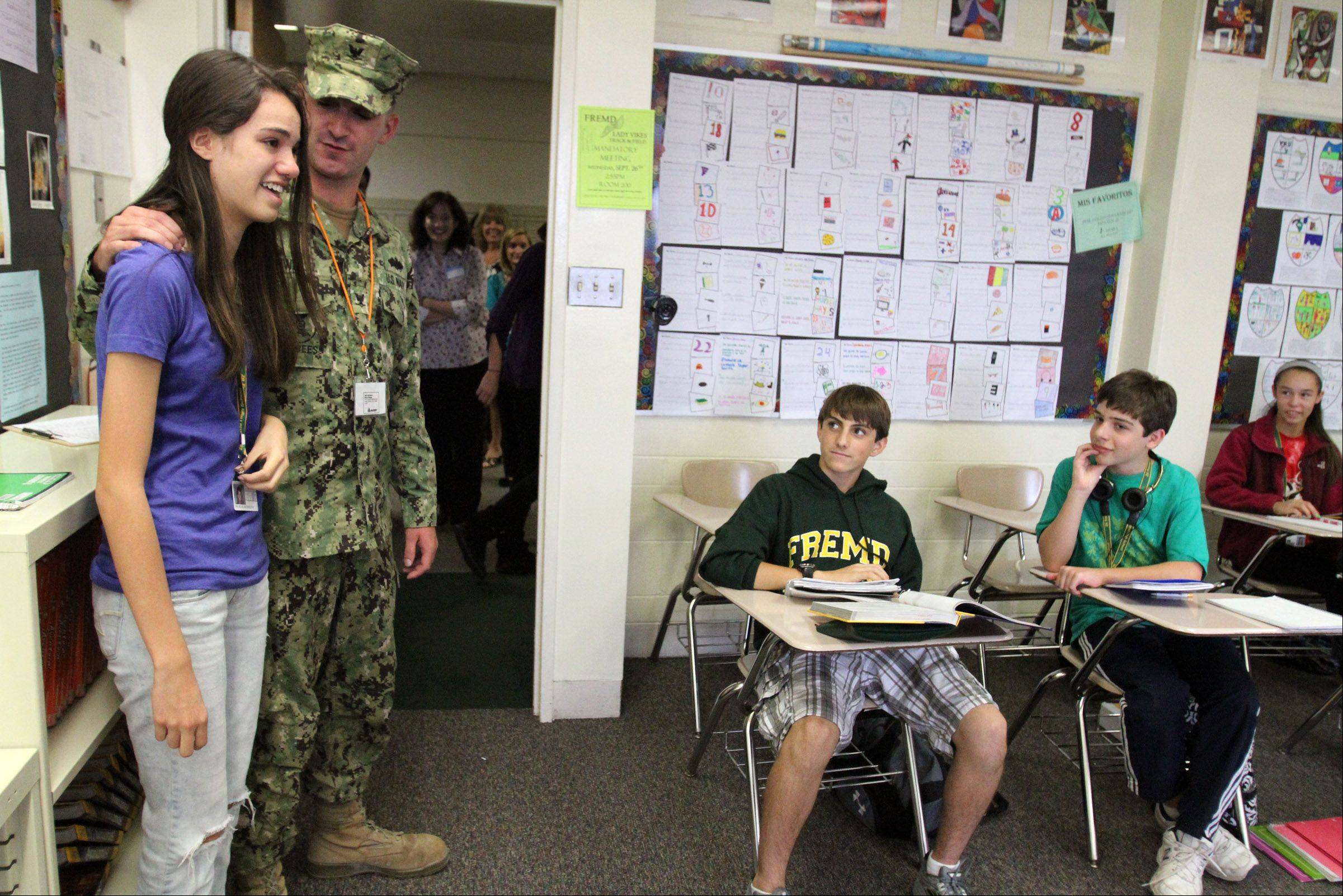Fremd High School freshman Jackie Trujillo introduces older brother, U.S. Navy Petty Officer 3rd Class Cameron Schwartz, to her Spanish class. He surprised his siblings Wednesday after returning from a deployment in Afghanistan.