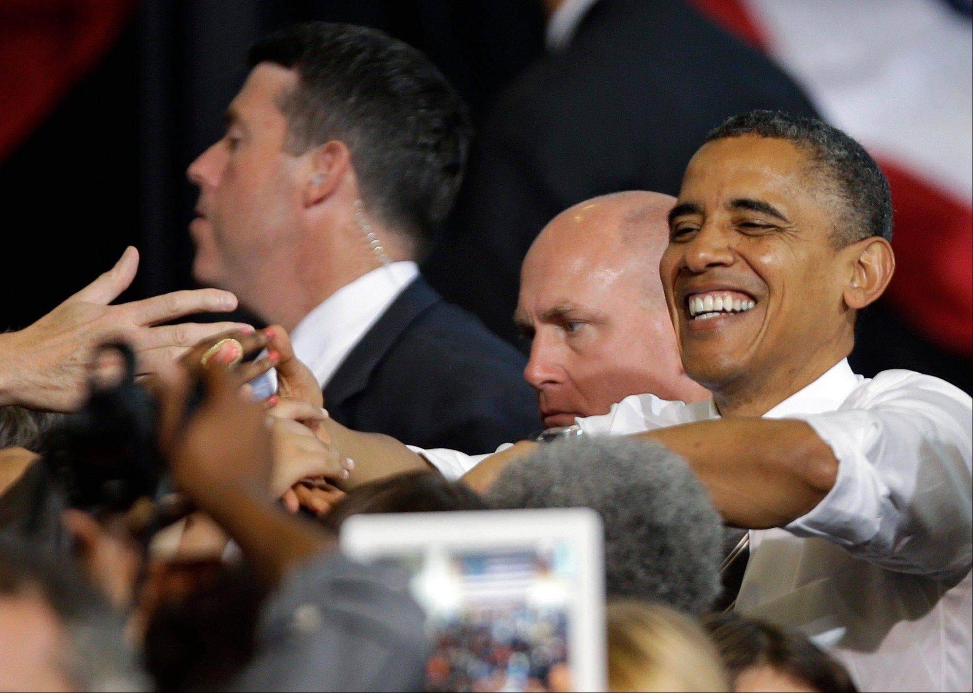 President Barack Obama greets supporters Wednesday after speaking at a campaign event at Bowling Green State University in Bowling Green, Ohio.