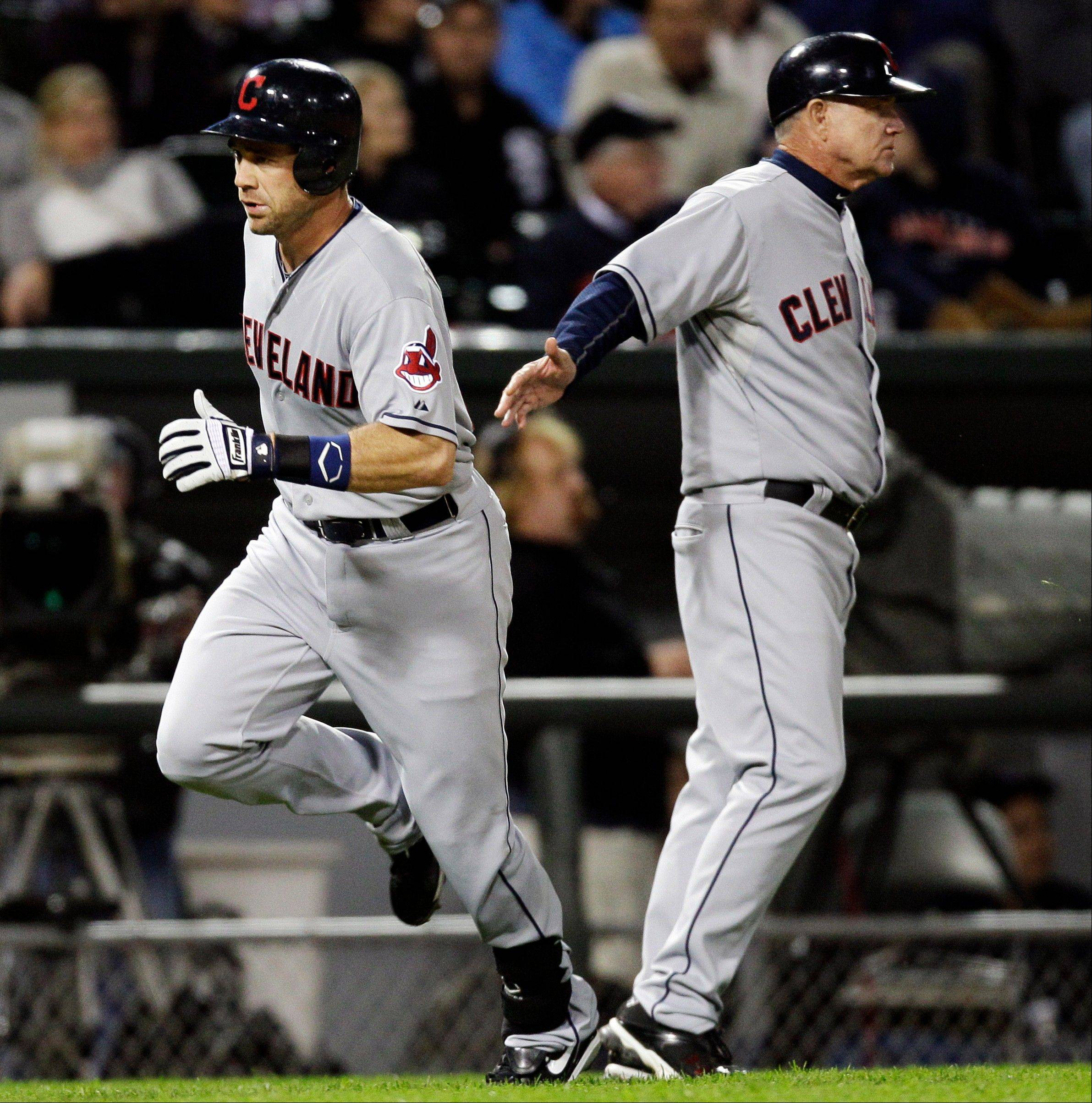 The Indians' Vinny Rottino celebrates with third-base coach Steve Smith after hitting a solo home run in the eighth inning to put the White Sox behind 6-4.