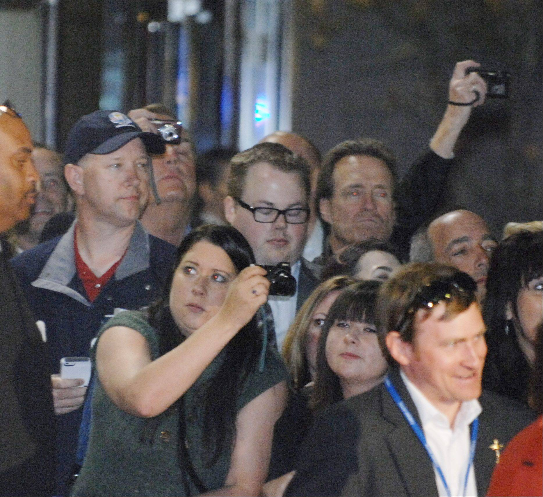 Fans look for their favorite stars at the the 39th Ryder Cup Gala at the Akoo Theatre in Rosemont Wednesday.