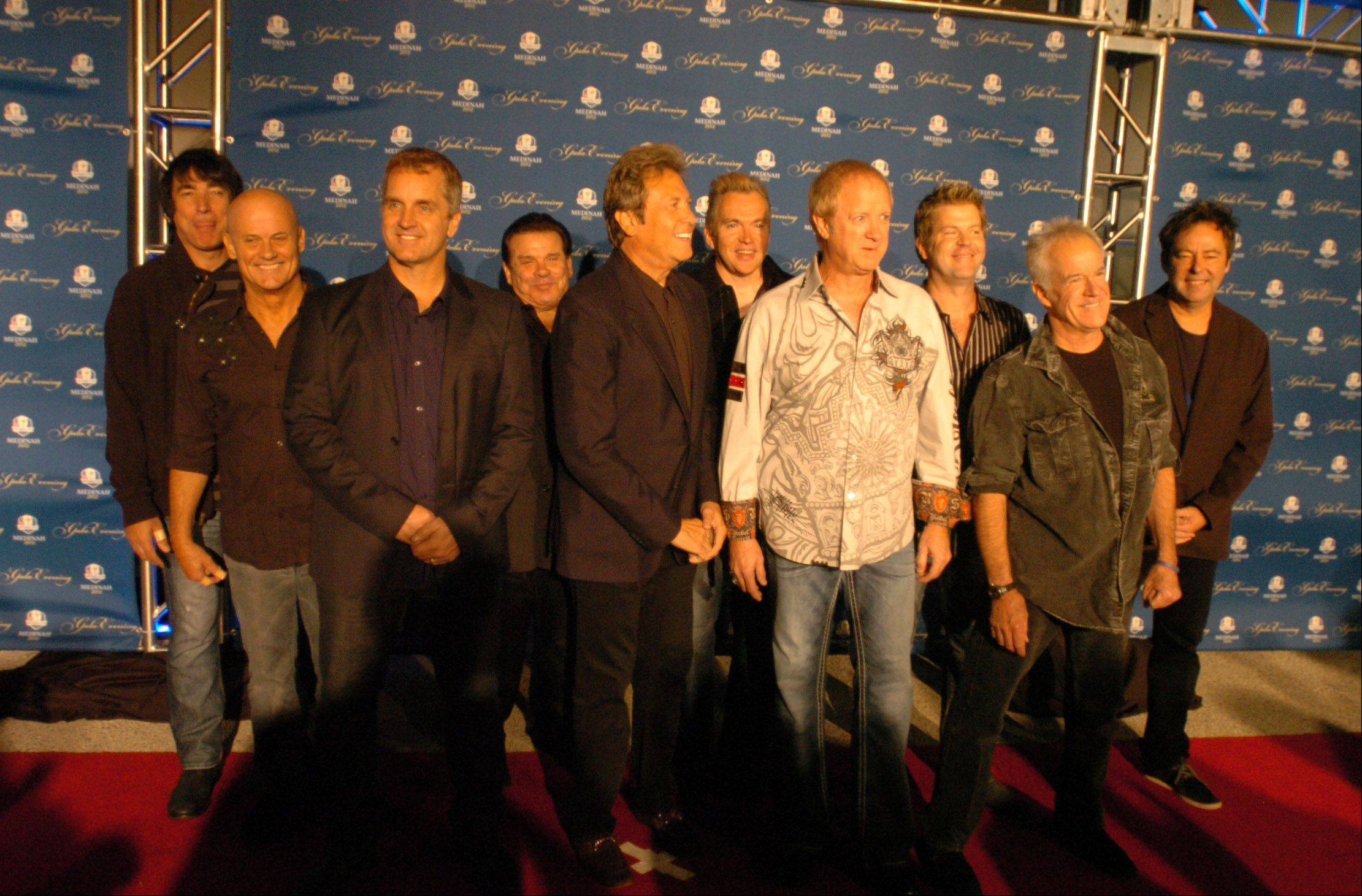 The band Chicago poses for photos on the red carpet.