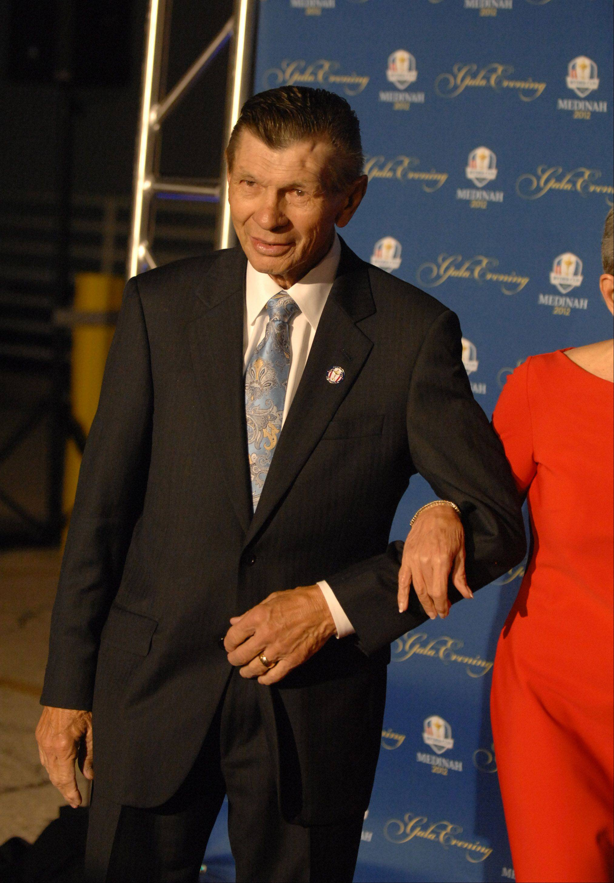 Blackhawks legend Stan Mikita walks the 39th Ryder Cup Gala red carpet at the Akoo Theatre in Rosemont Wednesday.