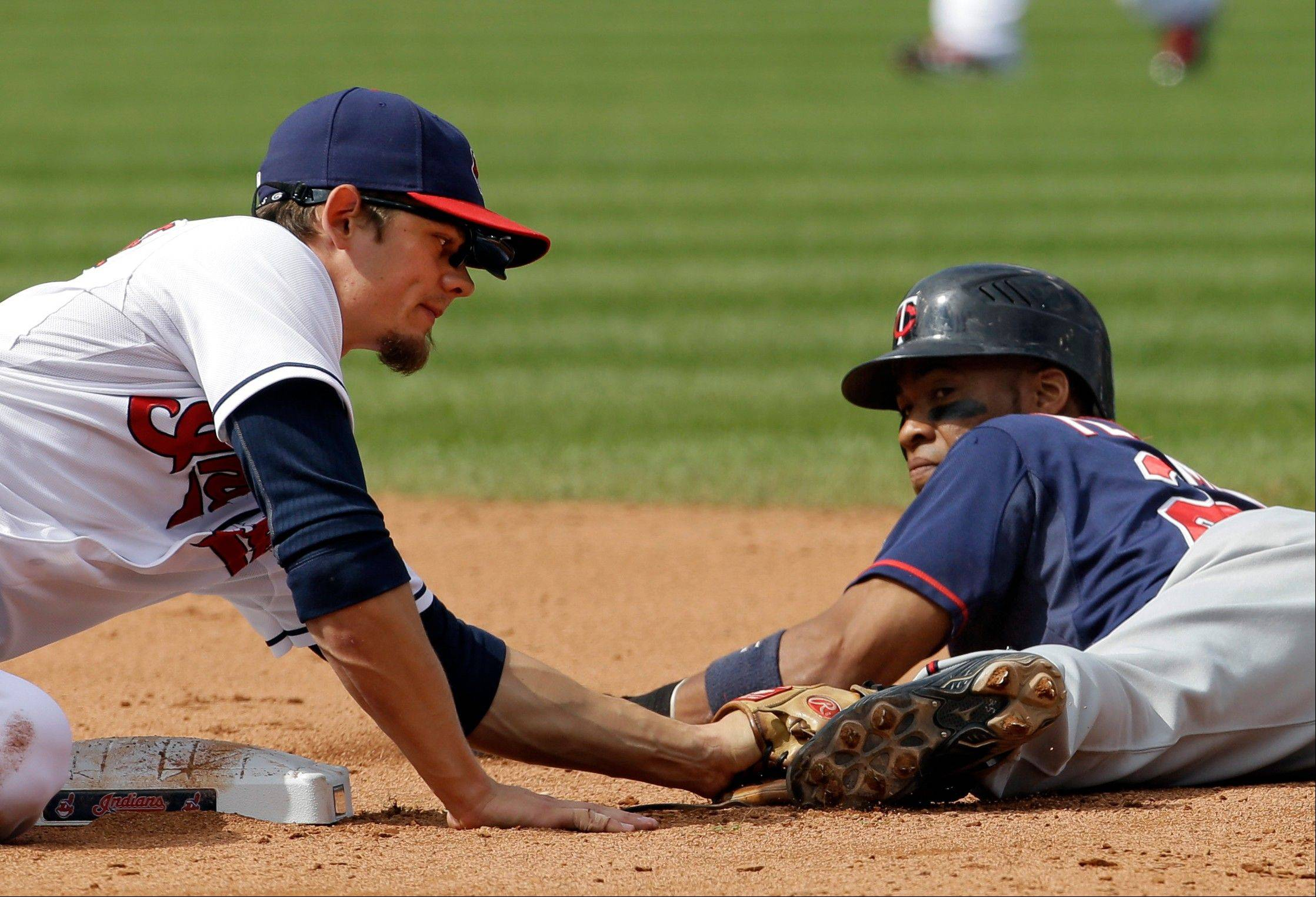Cleveland Indians shortstop Brent Lillibridge, left, tags out Minnesota Twins' Pedro Florimon trying to steal second earlier this season.