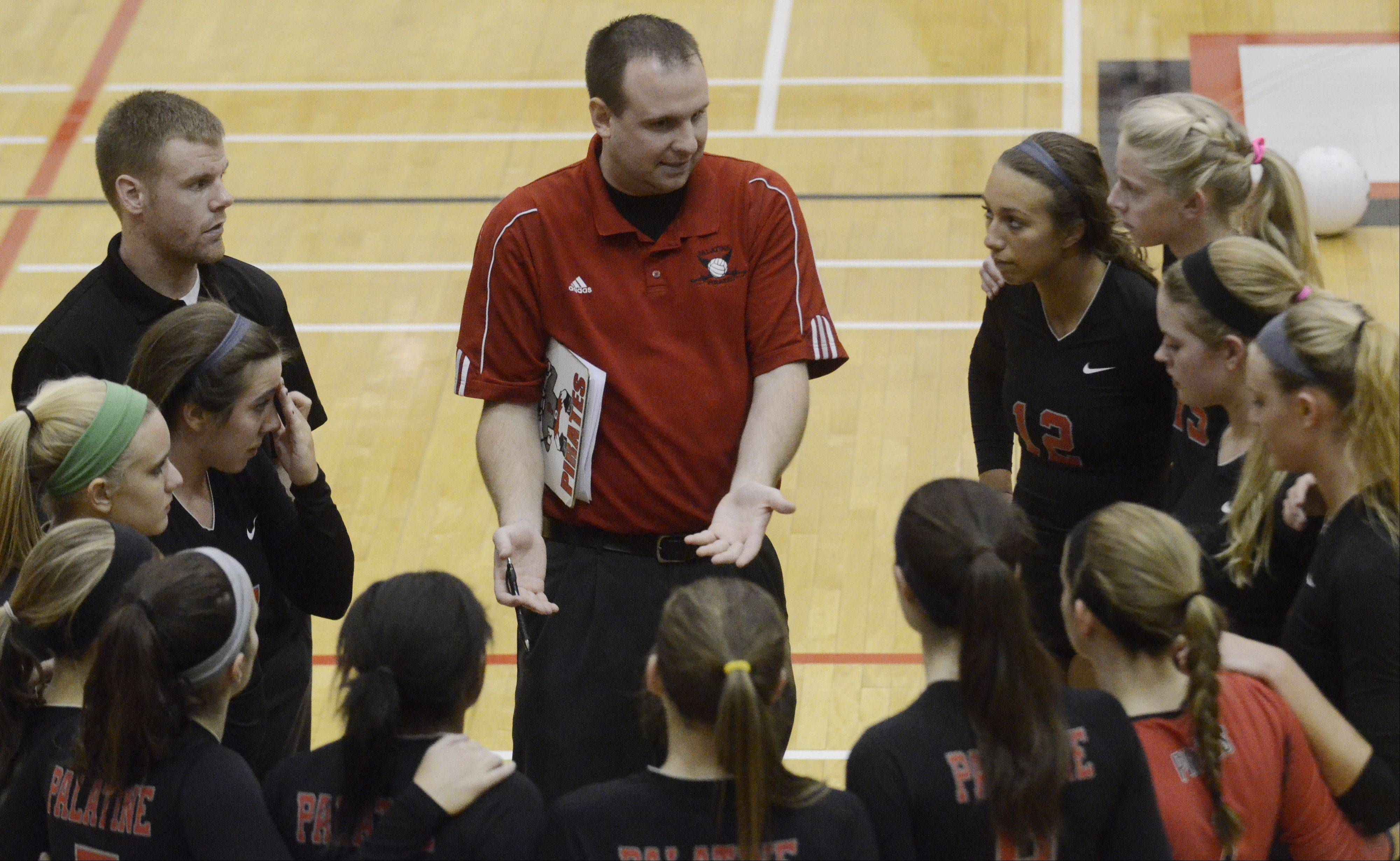 Palatine girls volleyball coach Dan Gavin leads his team during a timeout.