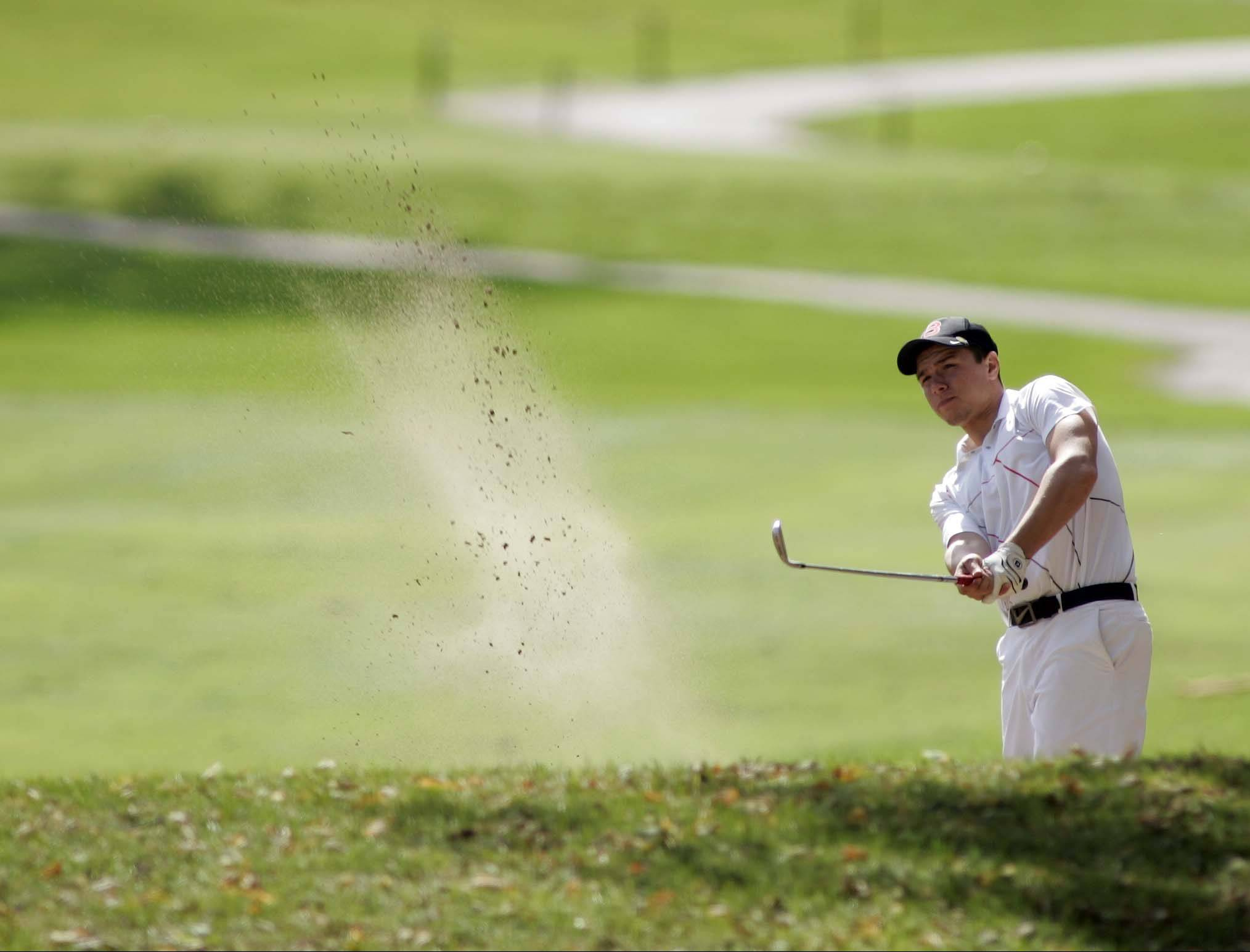 Batavia's Nathan Podraza, comes out of the sand on the second hole during the Upstate Eight boys golf tournament at St. Andrews in West Chicago Wednesday September 26, 2012.