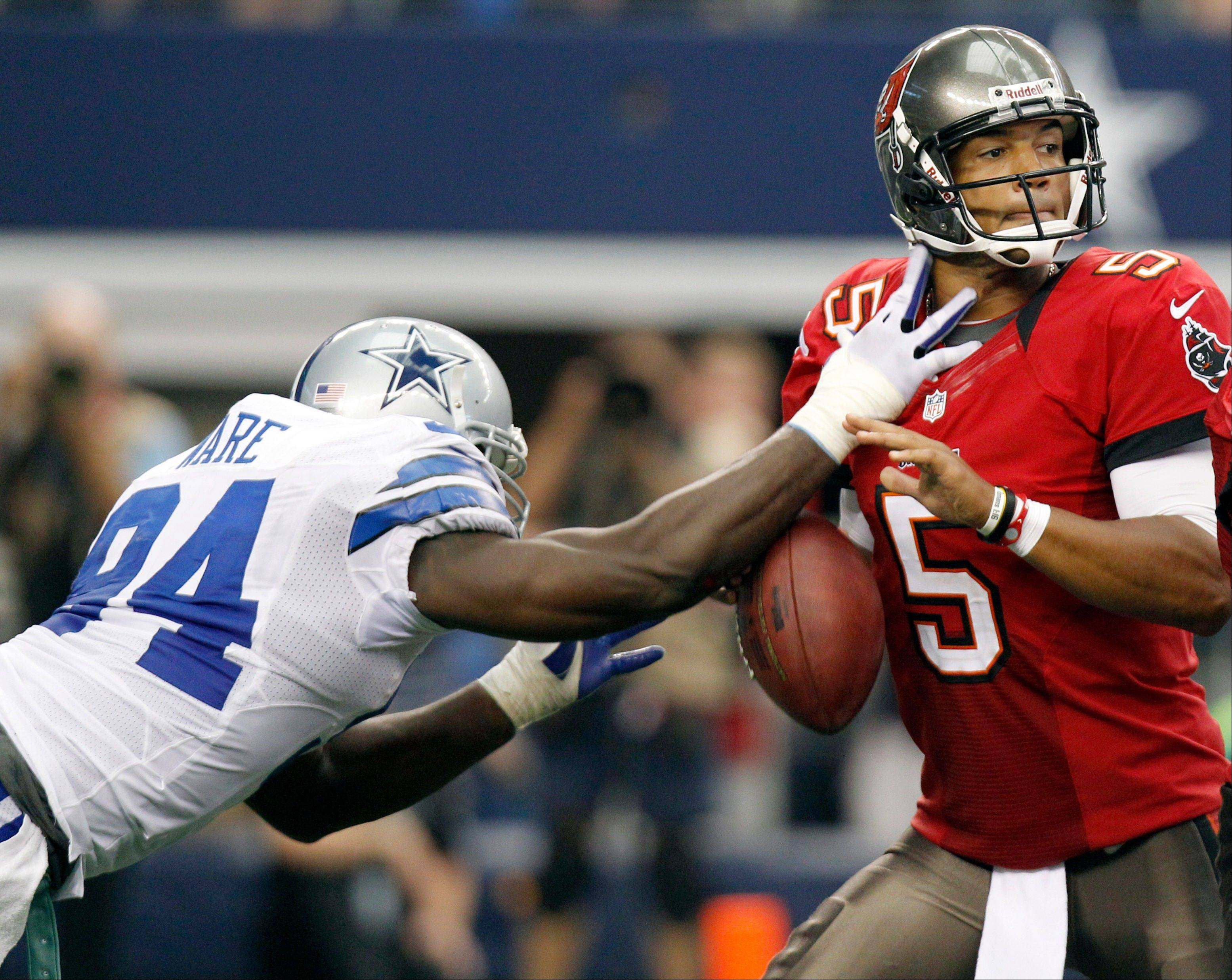 Dallas Cowboys outside linebacker DeMarcus Ware, here stripping the ball from Tampa Bay Buccaneers quarterback Josh Freeman, will be a big challenge for the Bears on Monday night.