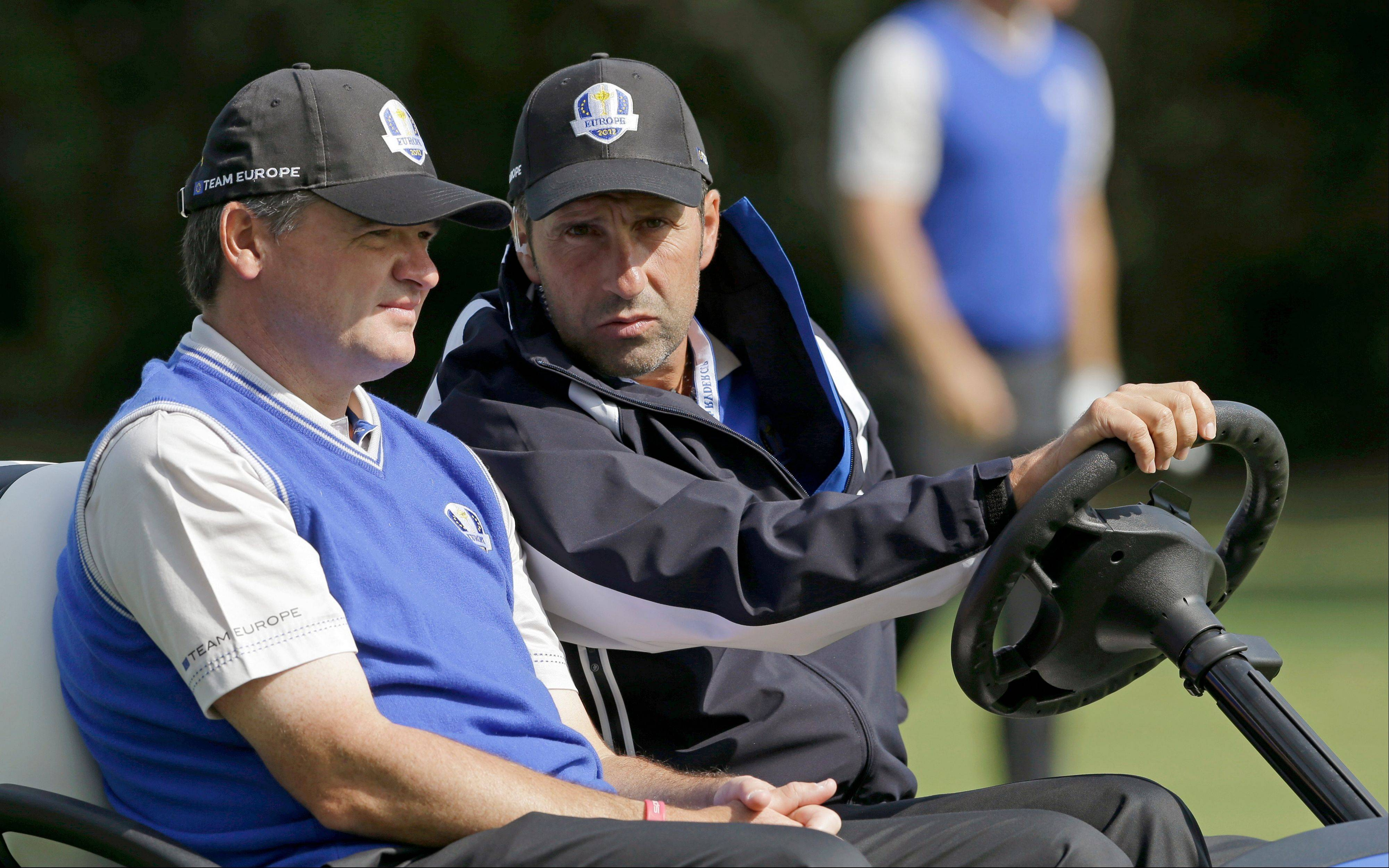 European team captain Jose Maria Olazabal talks to Paul Lawrie on the sixth hole Wednesday during a practice round at the Ryder Cup at Medinah Country Club.