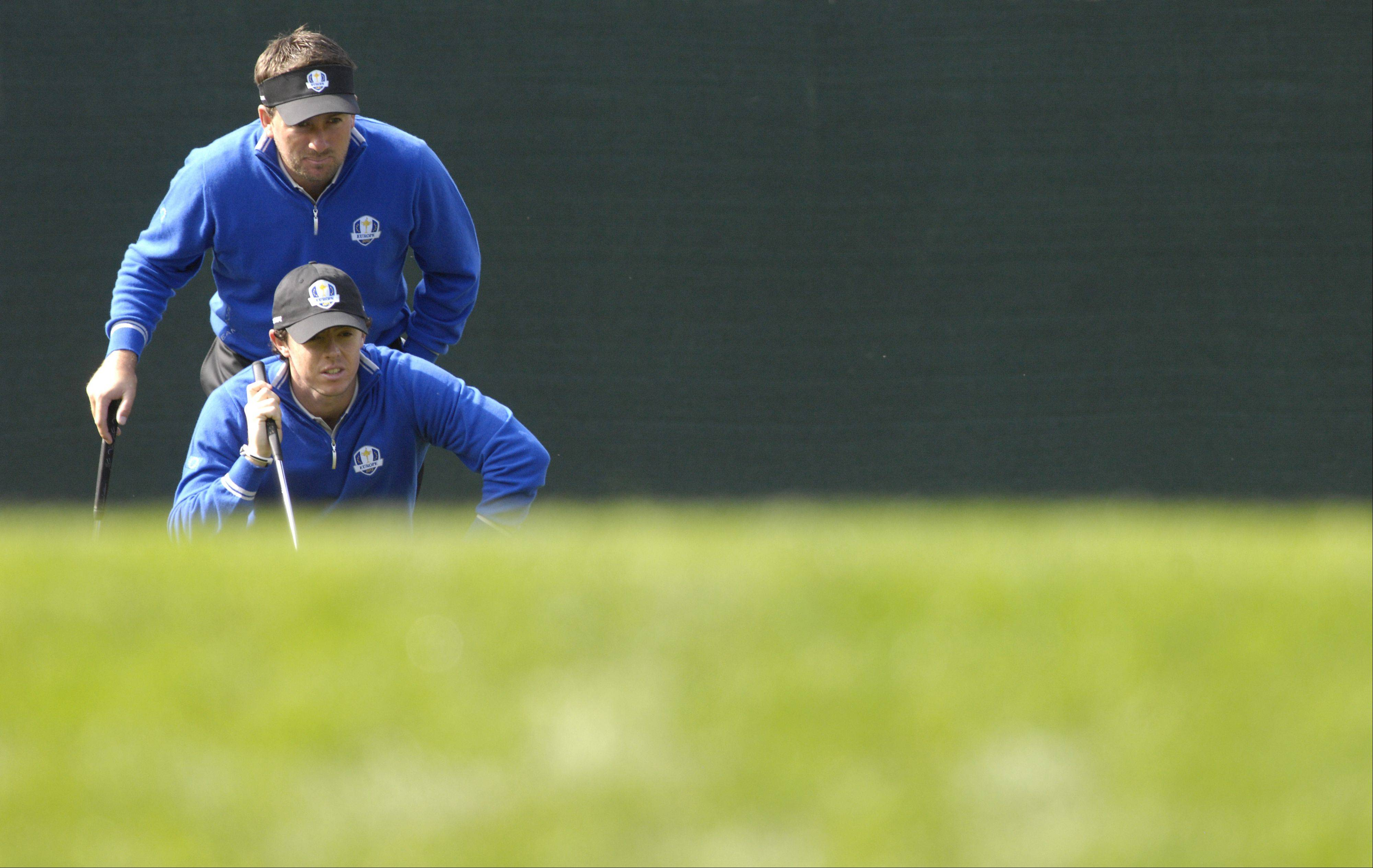 Graeme McDowell and Rory McIlroy of Team Europe line up a shot on the third green during practice Wednesday for the Ryder Cup. McIlroy, the No. 1 player in the world, finished 1-1-2 in his Ryder Cup debut in 2010.