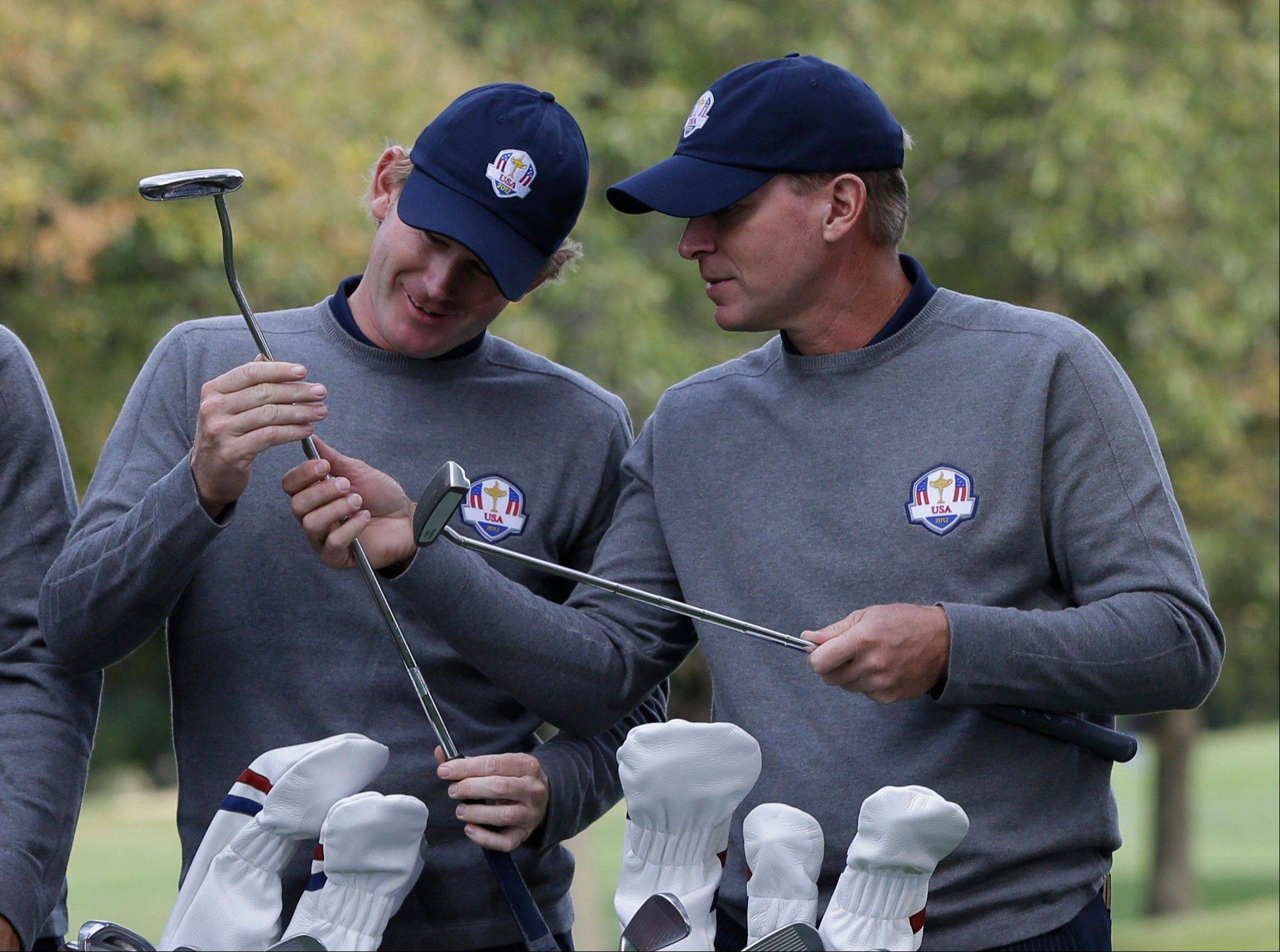 USA's Brandt Snedeker and Steve Stricker look over their putters Tuesday at Medinah Country Club. Snedeker said he's anxious for Friday's start.