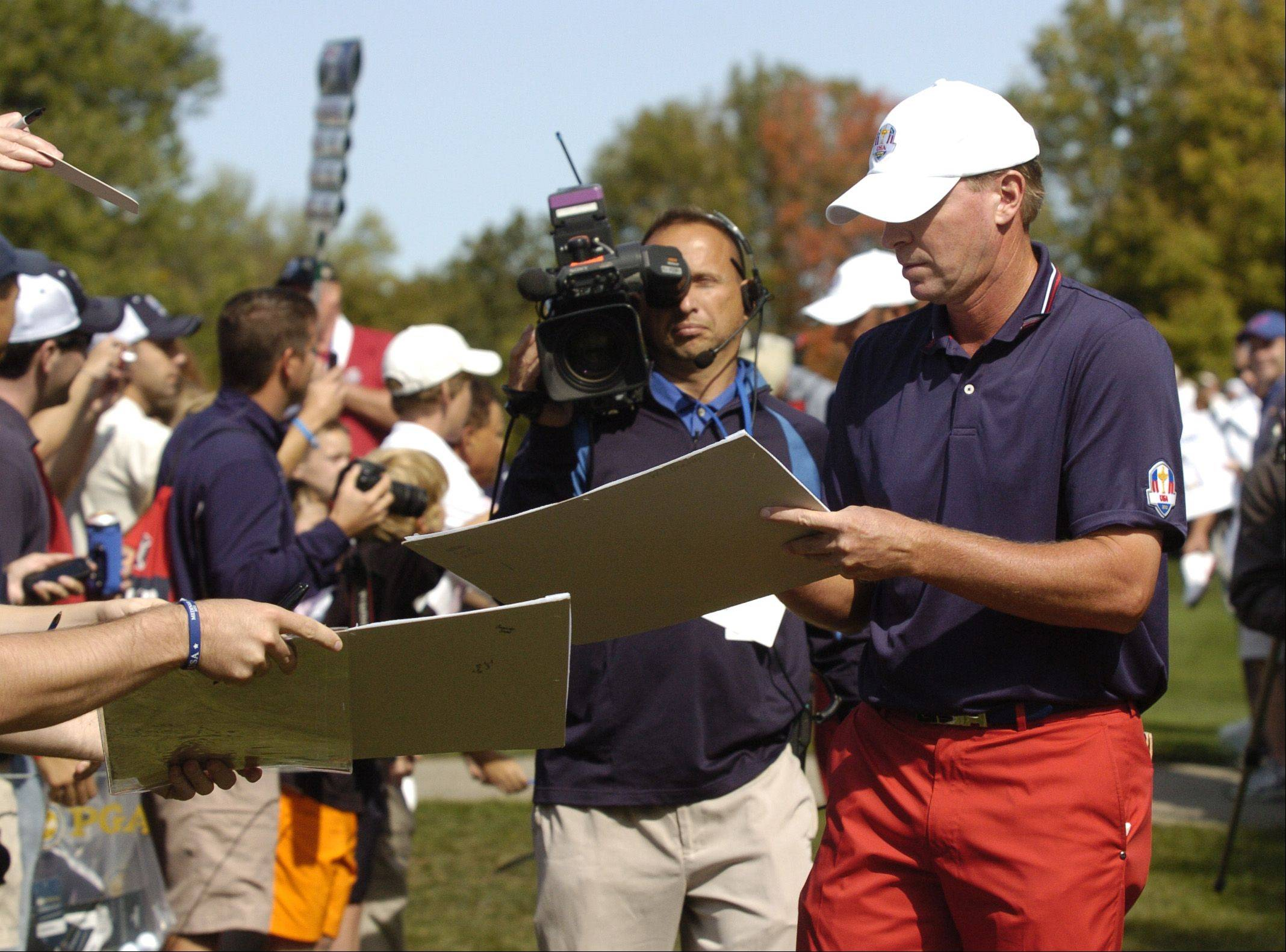 Steve Stricker of Team USA signs autographs.