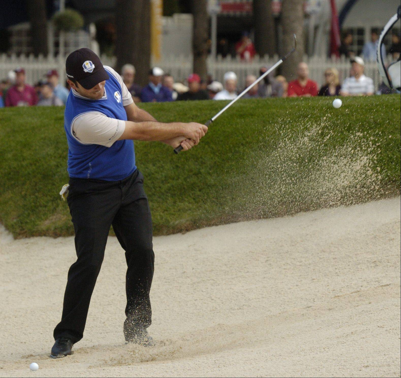 Francesco Molinari of Team Europe chips out the the sand.
