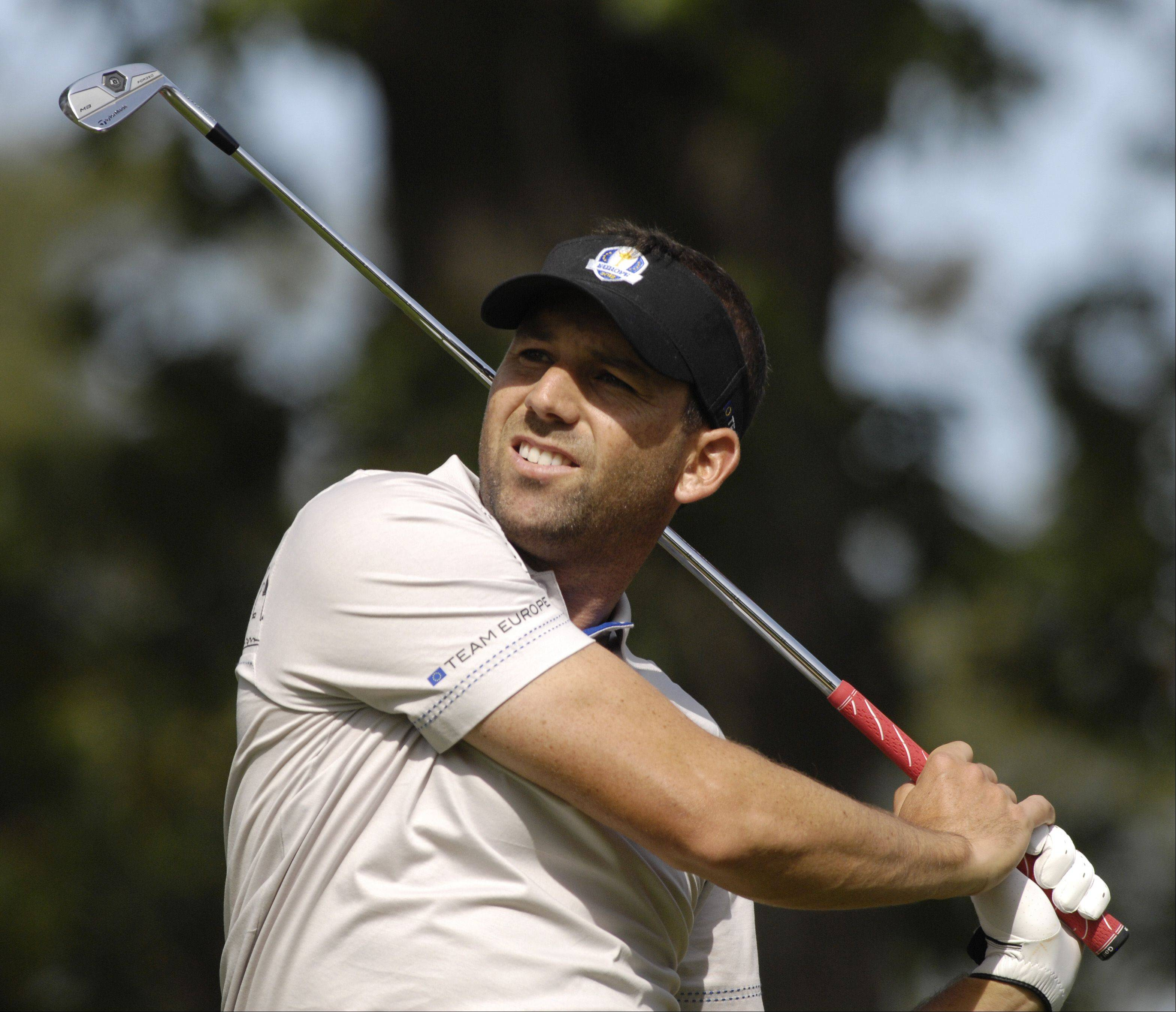 Sergio Garcia of Team Europe watches his drive.