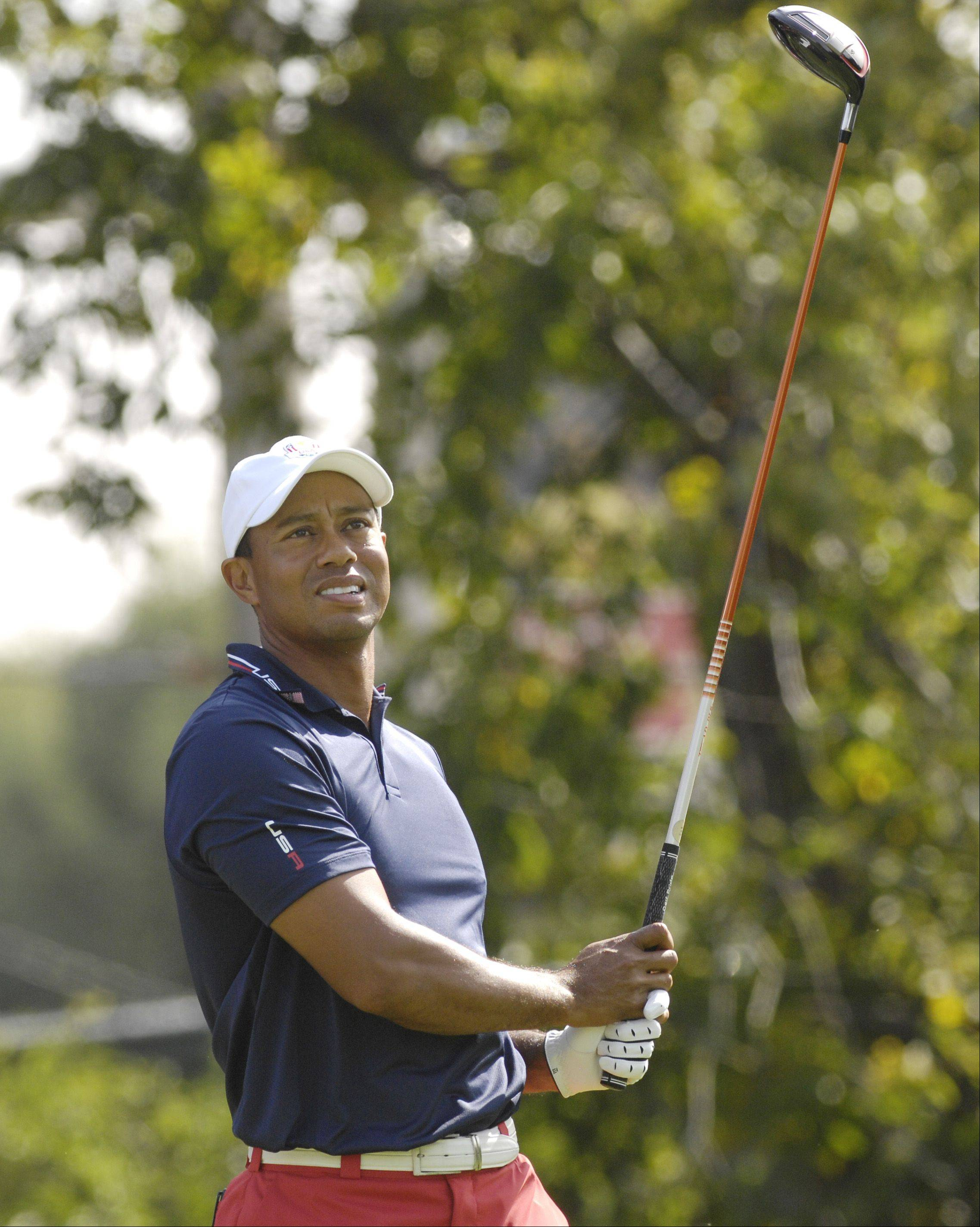 Tiger Woods tees off during practice .