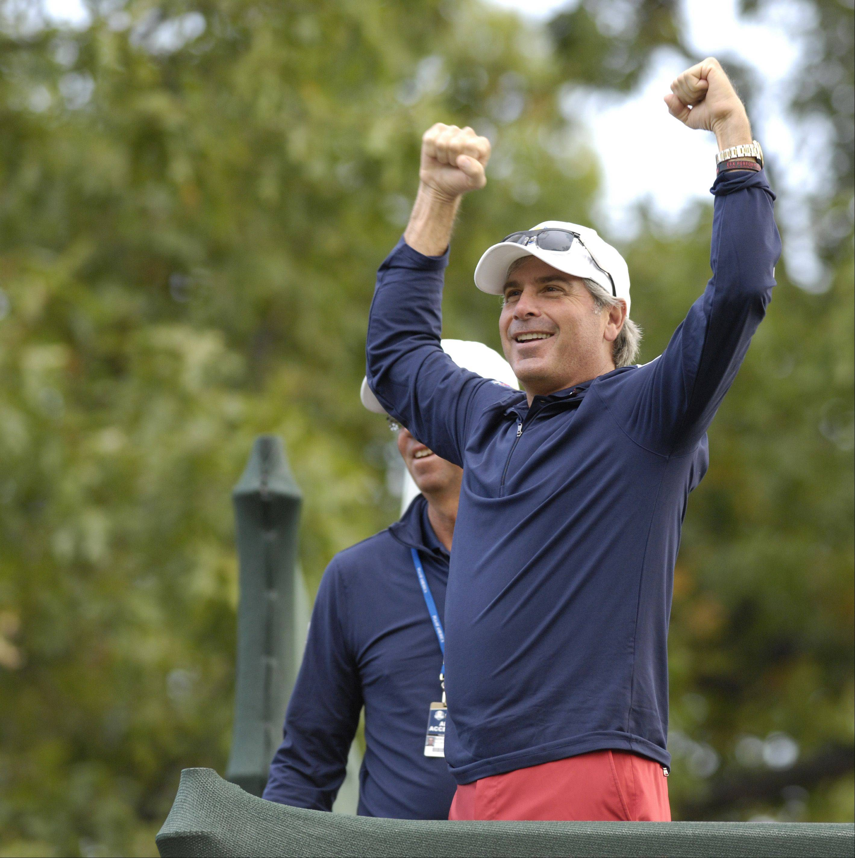 Fred Couples, an assistant United States Ryder Cup captain, gets the crowd worked up as the U.S. takes to the first tee during practice.