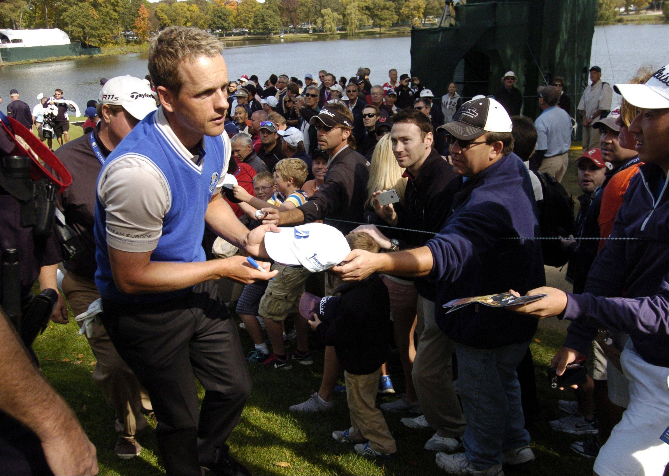 Luke Donald of Team Europe signs autographs.