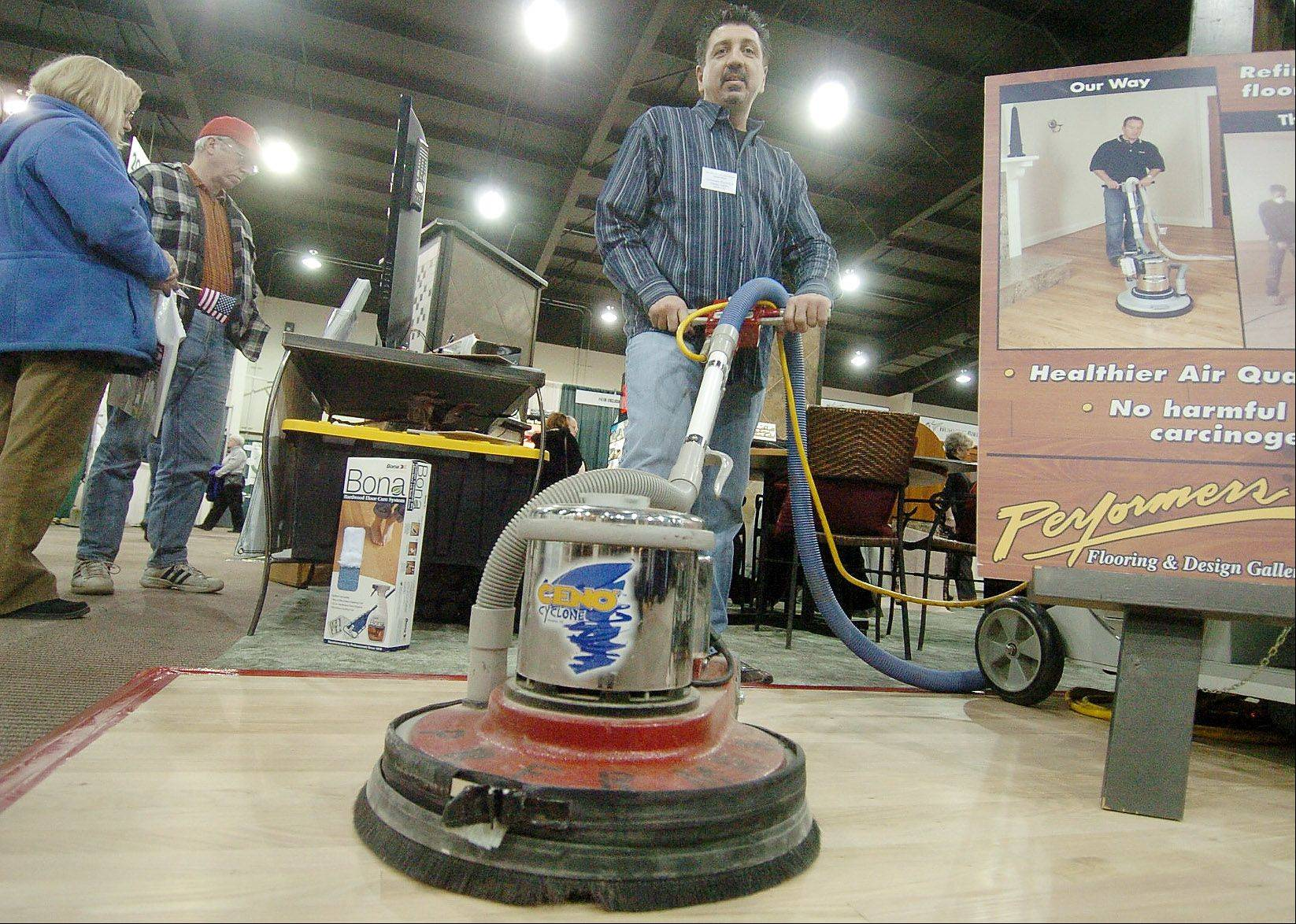 John Psyhos of Performers Flooring and Design Gallery of Bloomingdale demonstrates floor sanding at The Old House New House Home Show at Pheasant Run Resort.