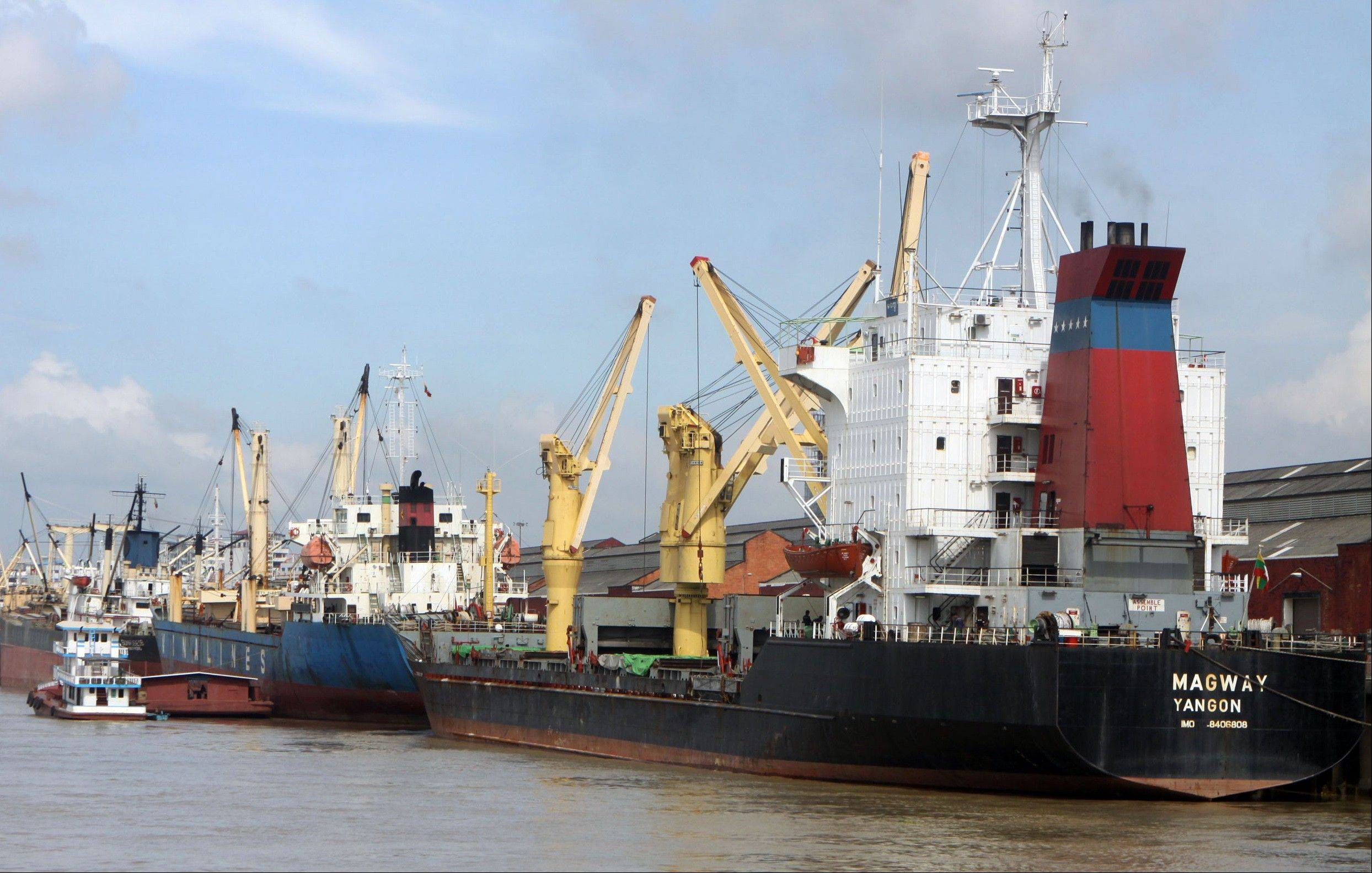 Cargo ships dock at a jetty in Yangon, Myanmar, Thursday.
