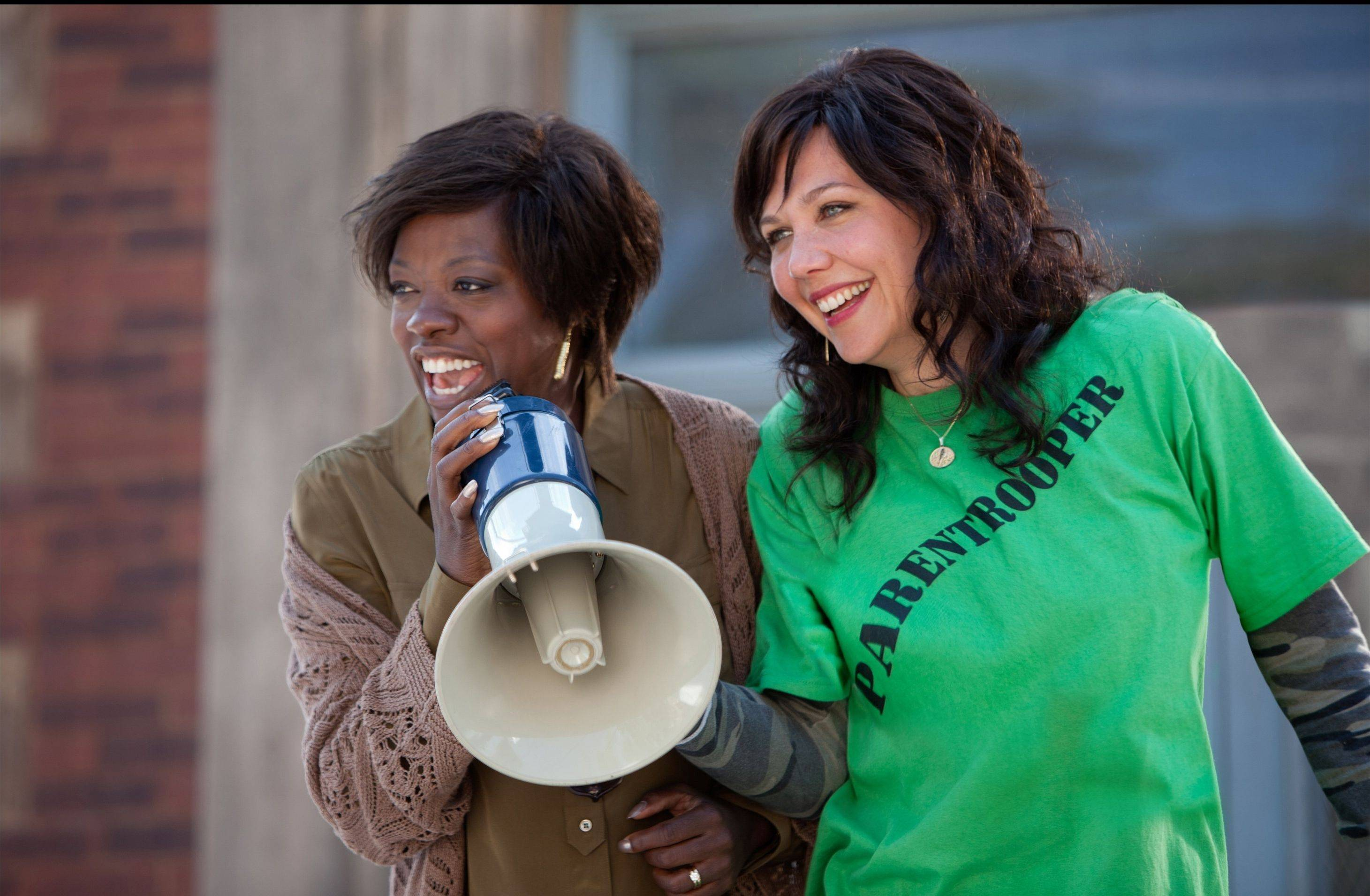 "Teacher Nona (Viola Davis) rallies supporters of a parent empowerment law to take over her school while Jamie (Maggie Gyllenhaal) watches in the drama ""Won't Back Down."""