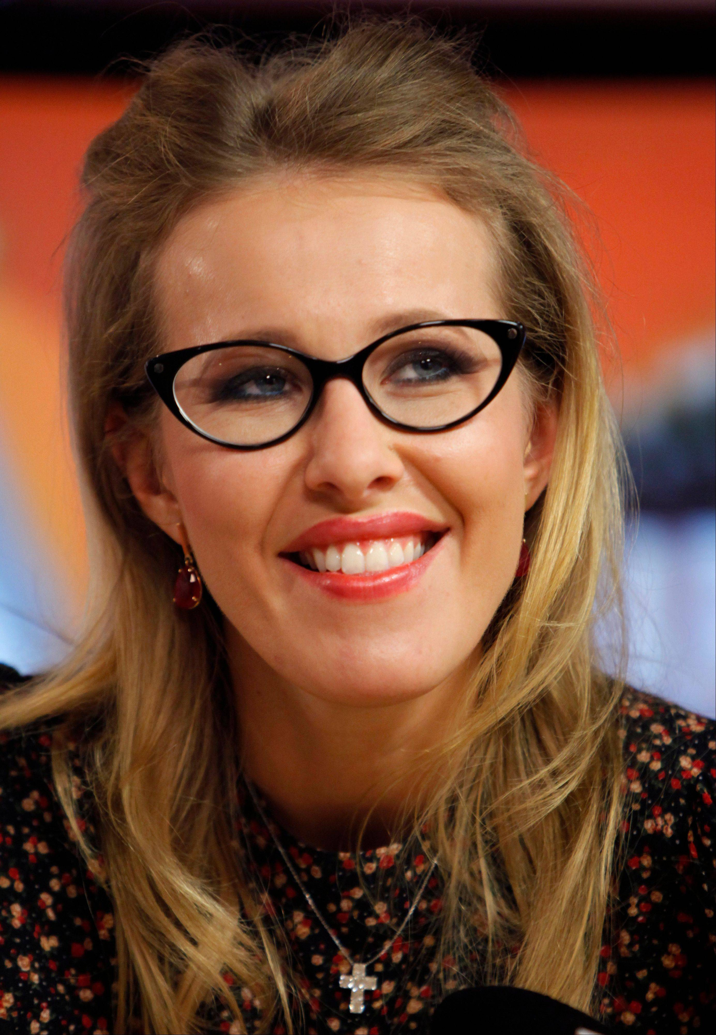 Associated Press/Jan. 18, 2012 Russian socialite and TV host Kseniya Sobchak, daughter of the late St. Petersburg mayor, Anatoly Sobchak, speaks to journalists during her interview at a radio station in Moscow.