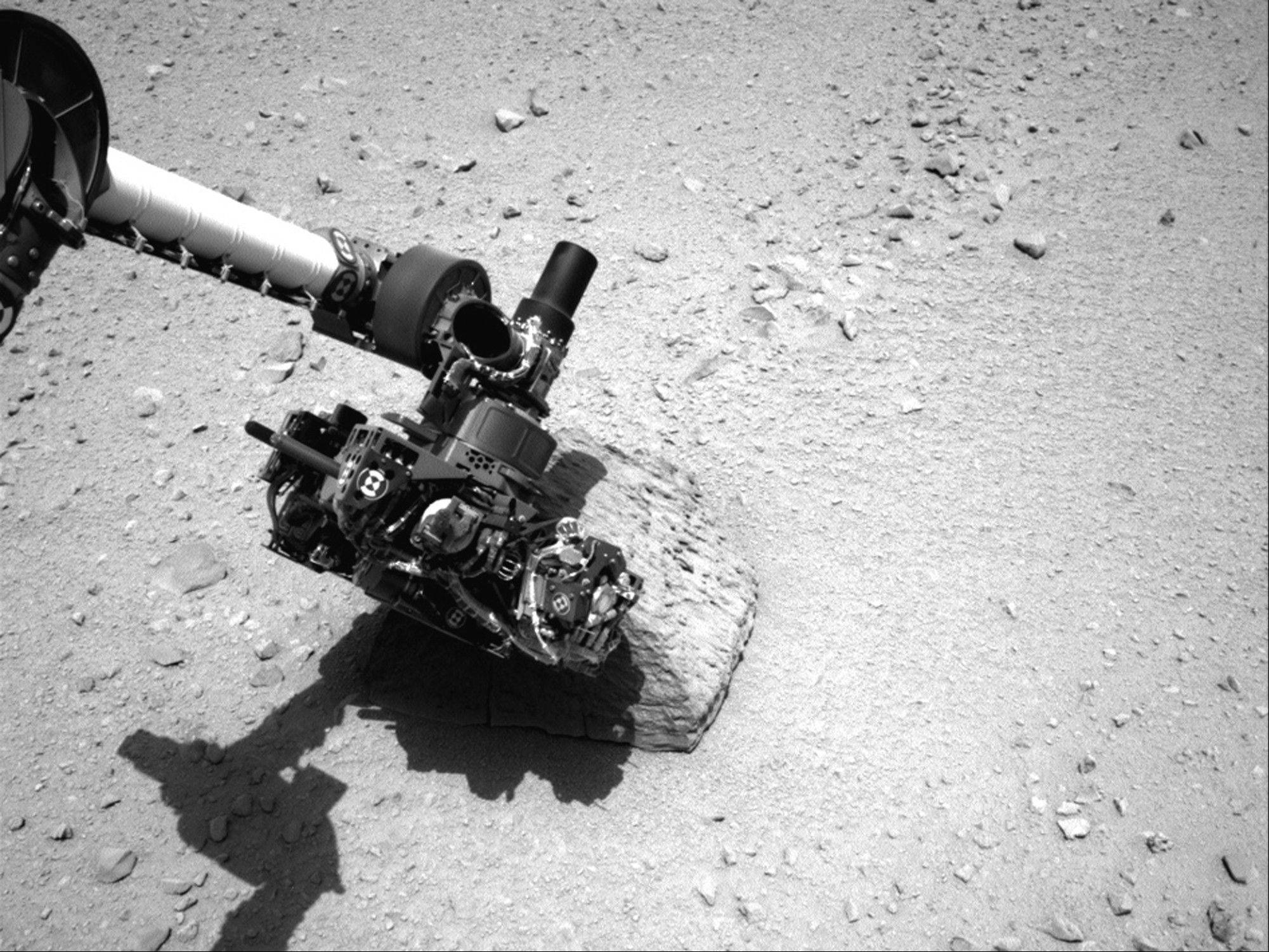 Associated Press/NASA The robotic arm of NASA's Mars rover Curiosity with the first rock touched by an instrument on the arm.