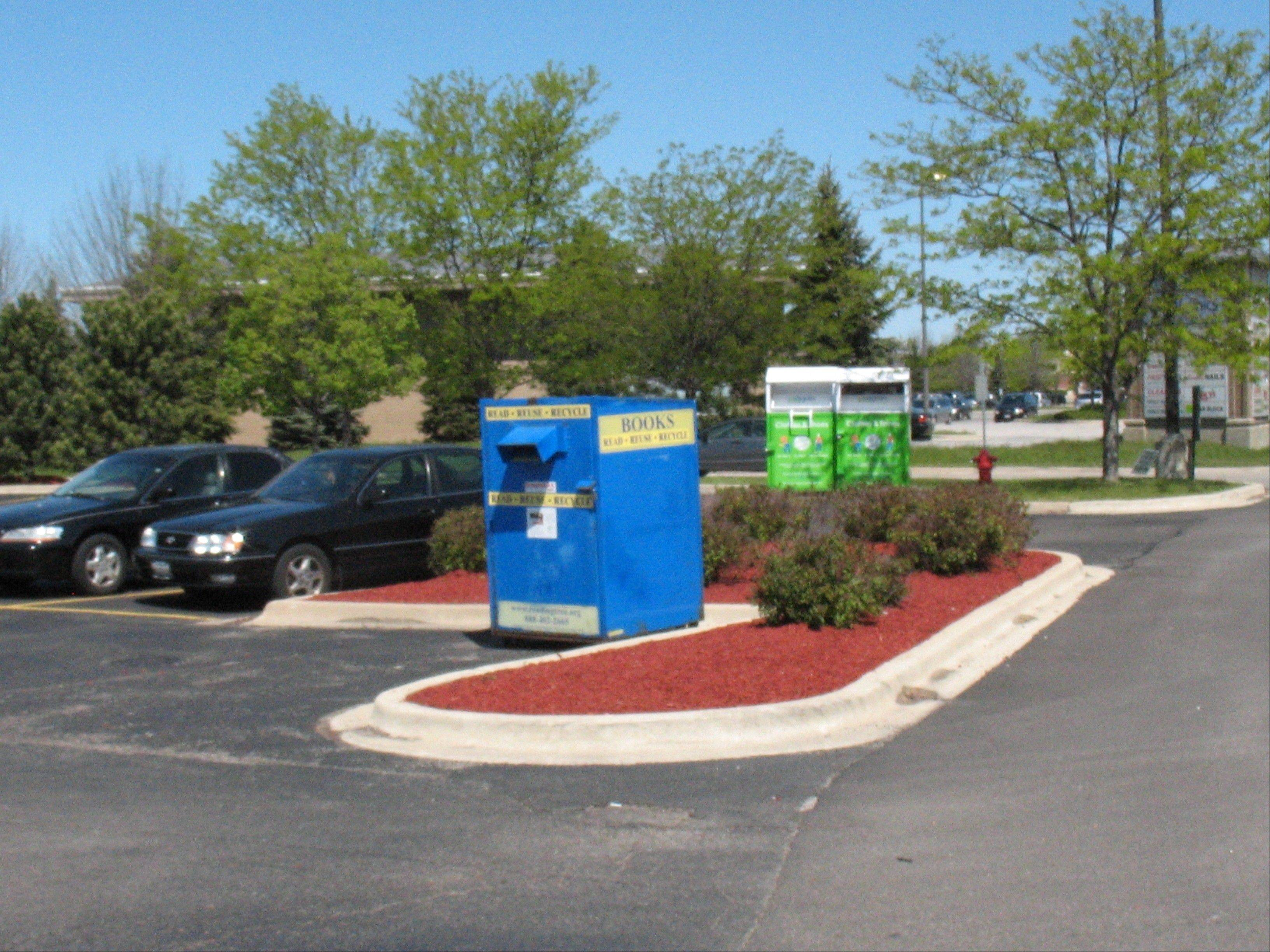 Geneva is considering prohibiting collection boxes such as these from being placed in parking lots, such as this one in a shopping center at Fabyan Parkway and Randall Road. City development staff say the boxes take up parking spaces, that people leave donations outside of them, and that the boxes are poorly maintained.