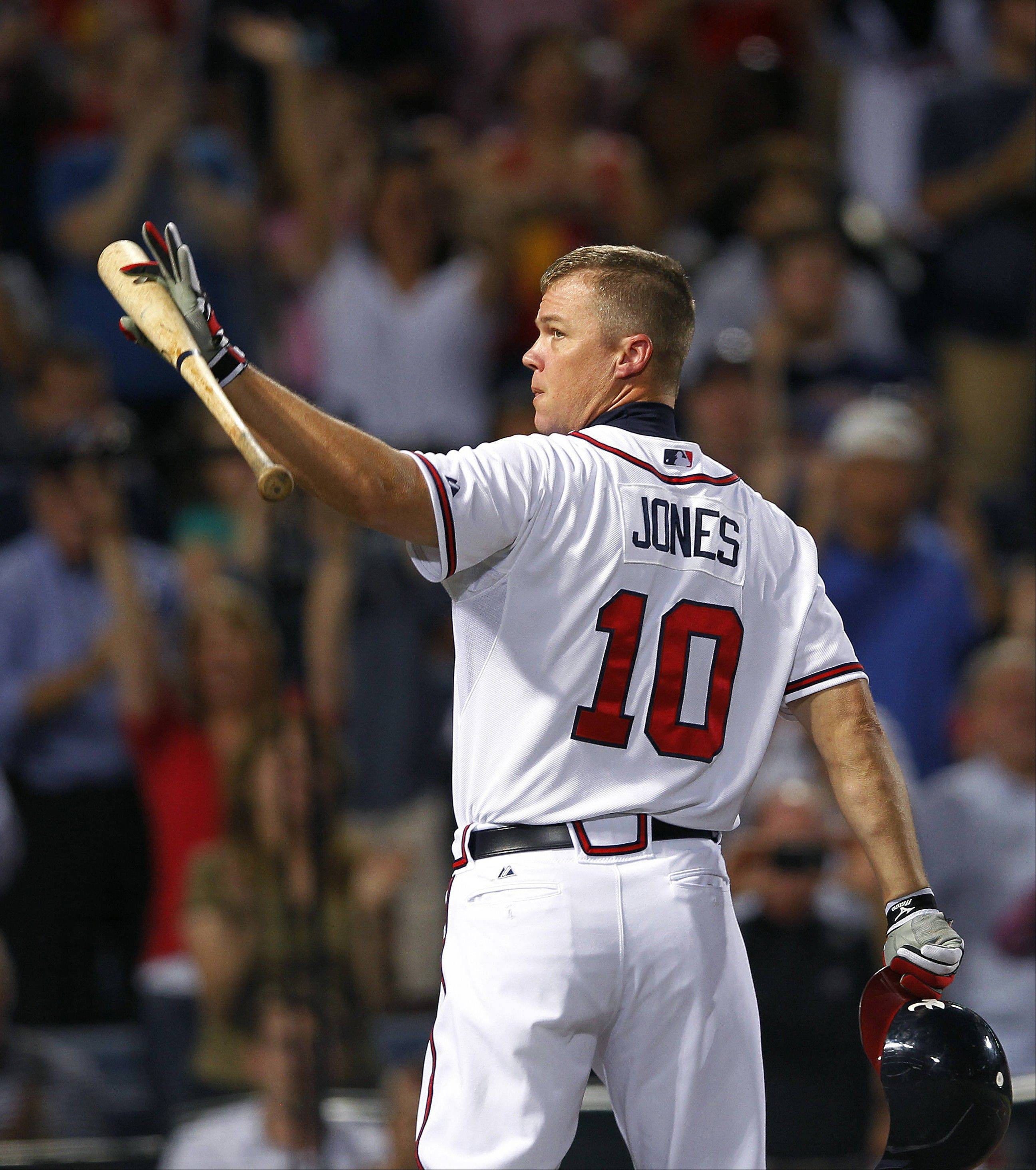 Braves third baseman Chipper Jones waves to the crowd before batting in the second inning Thursday against the Miami Marlins in Atlanta.