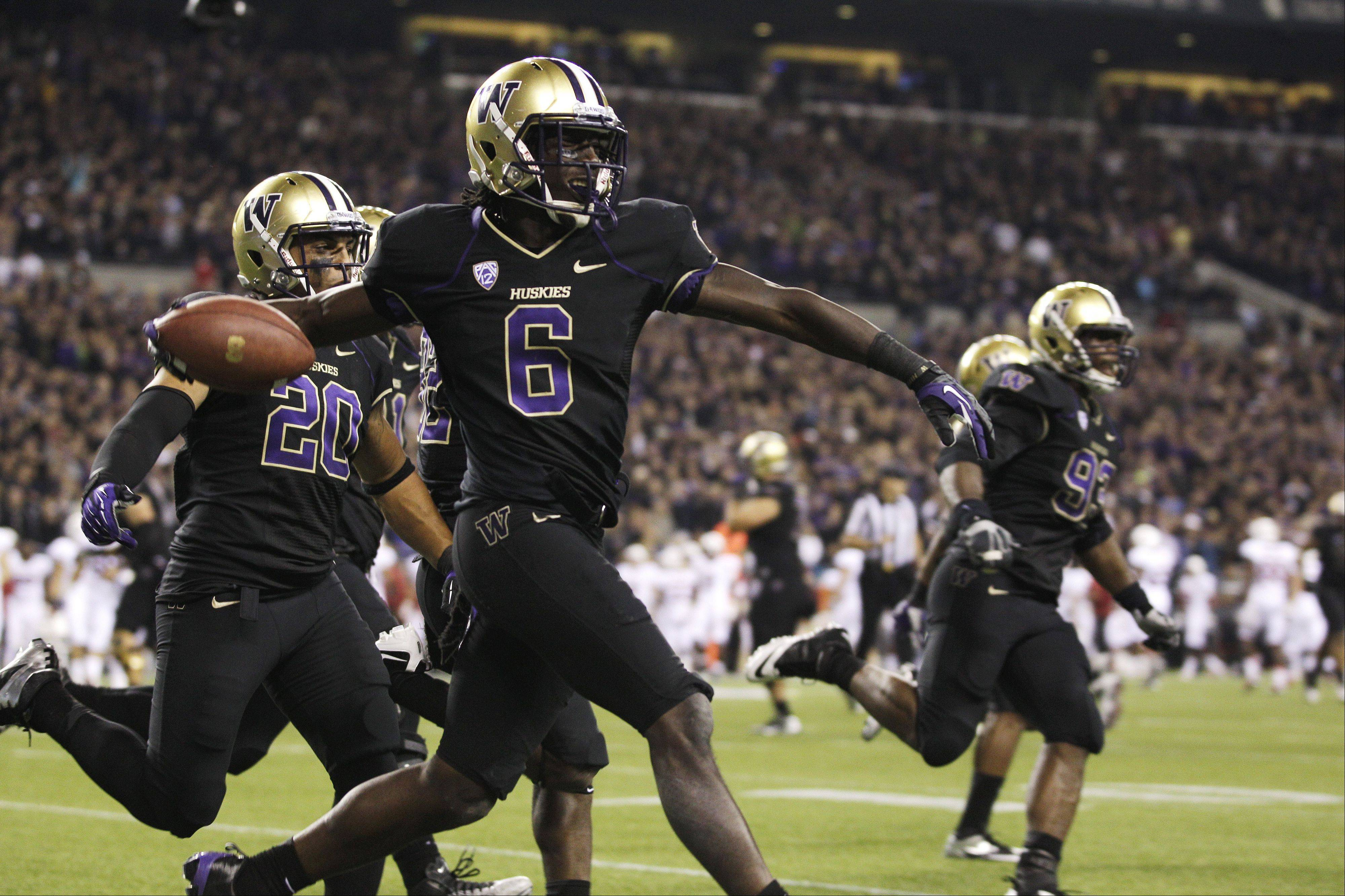 Washington's Desmond Trufant celebrates his interception against Stanford late in the second half Thursday in Seattle.