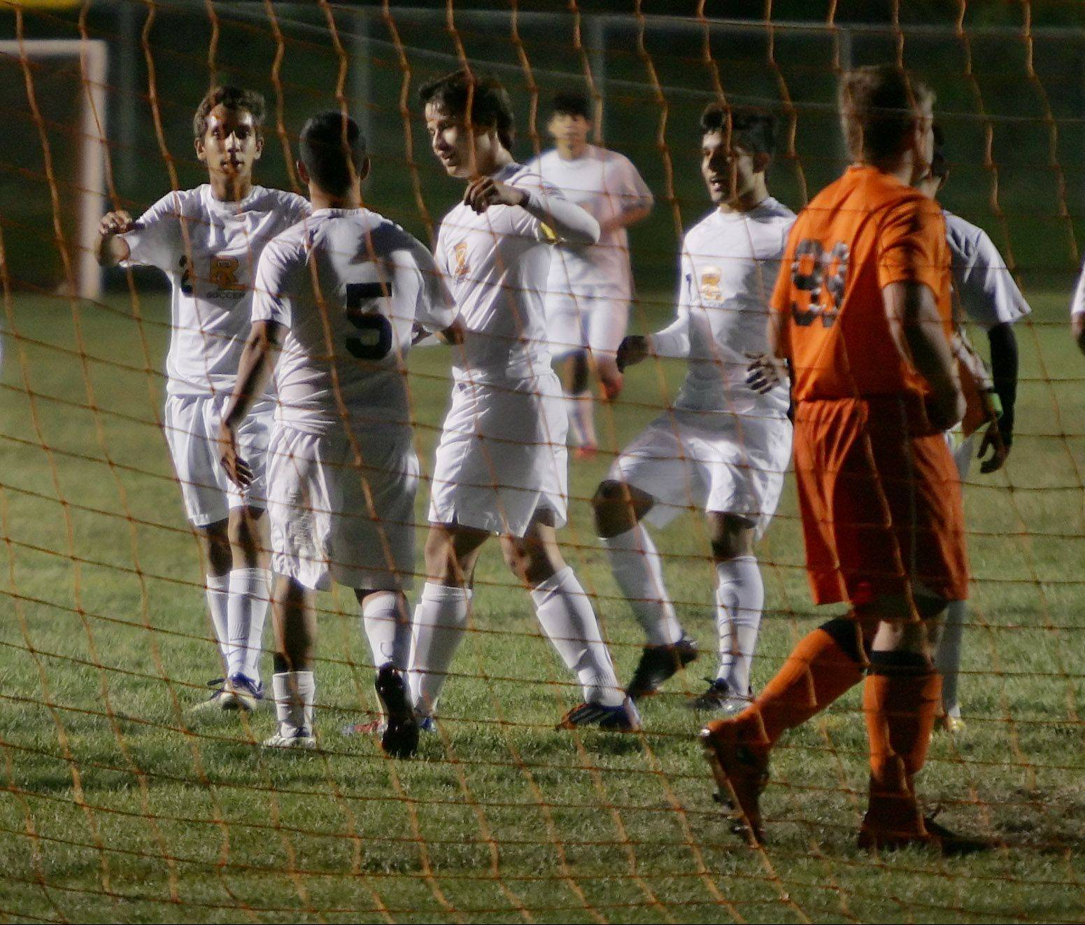 Round Lake players swarm Jose Sedano after he scores the first goal of the game Thursday against visiting Antioch.