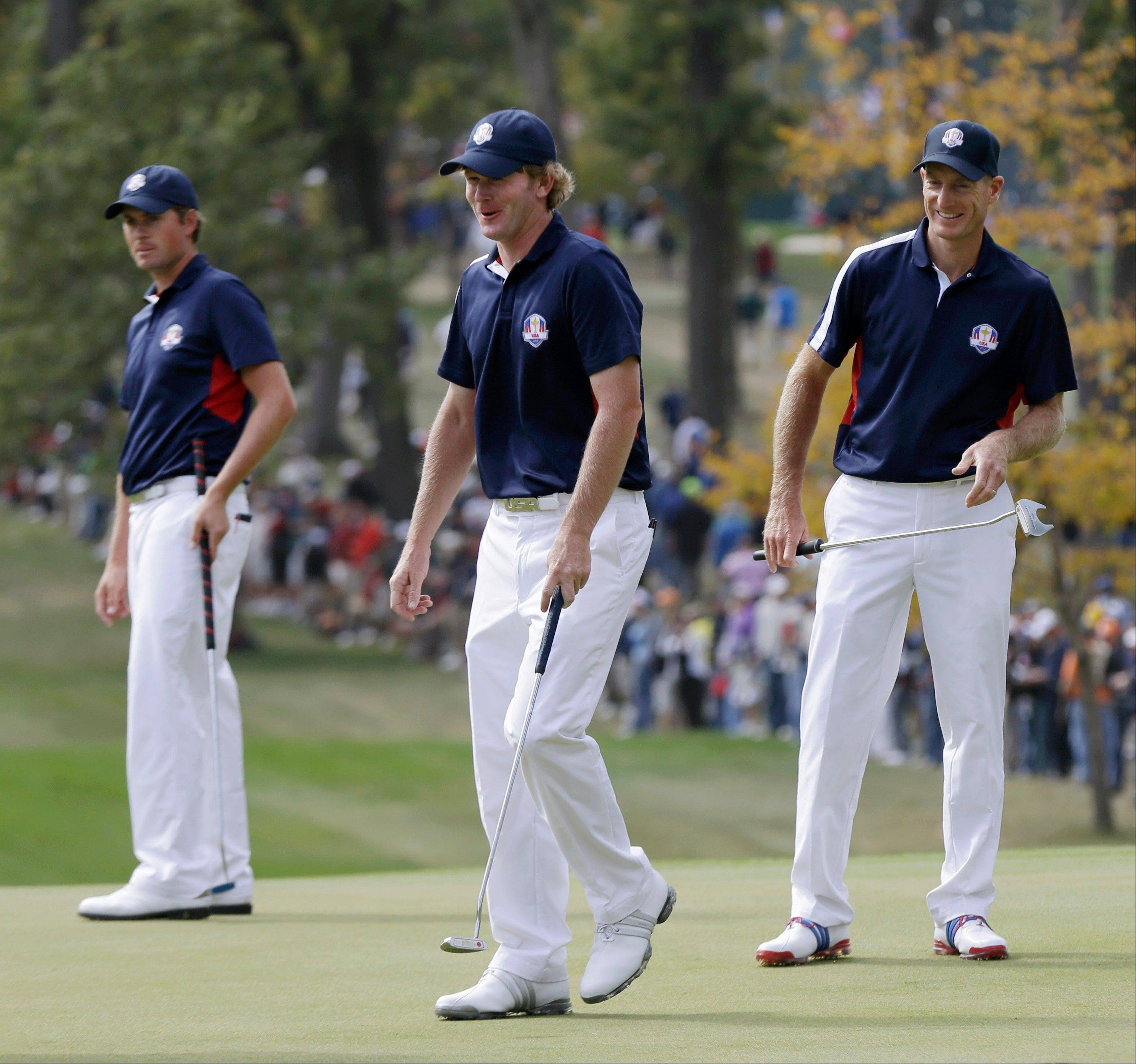 USA's Webb Simpson, left to right, Brandt Snedeker and Jim Furyk look over the green on the fourth hole Thursday during a practice round at the Ryder Cup at Medinah Country Club.