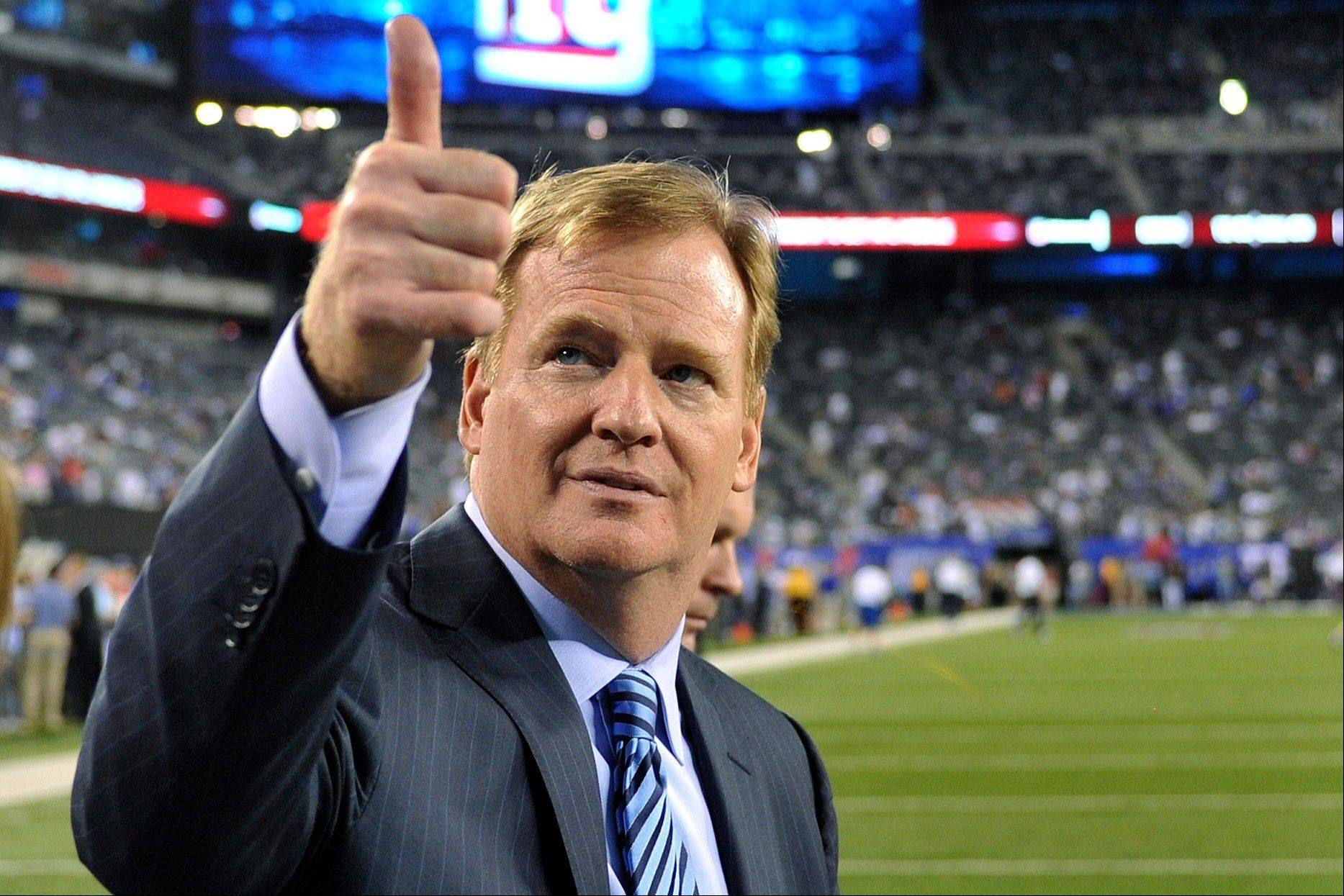 Commissioner Roger Goodell gestures to fans before a game between the New York Giants and the Dallas Cowboys in East Rutherford, N.J. The NFL and referees union reached a tentative agreement on Wednesday to end a three-month lockout that triggered a wave of frustration and anger over replacement officials and threatened to disrupt the rest of the season.