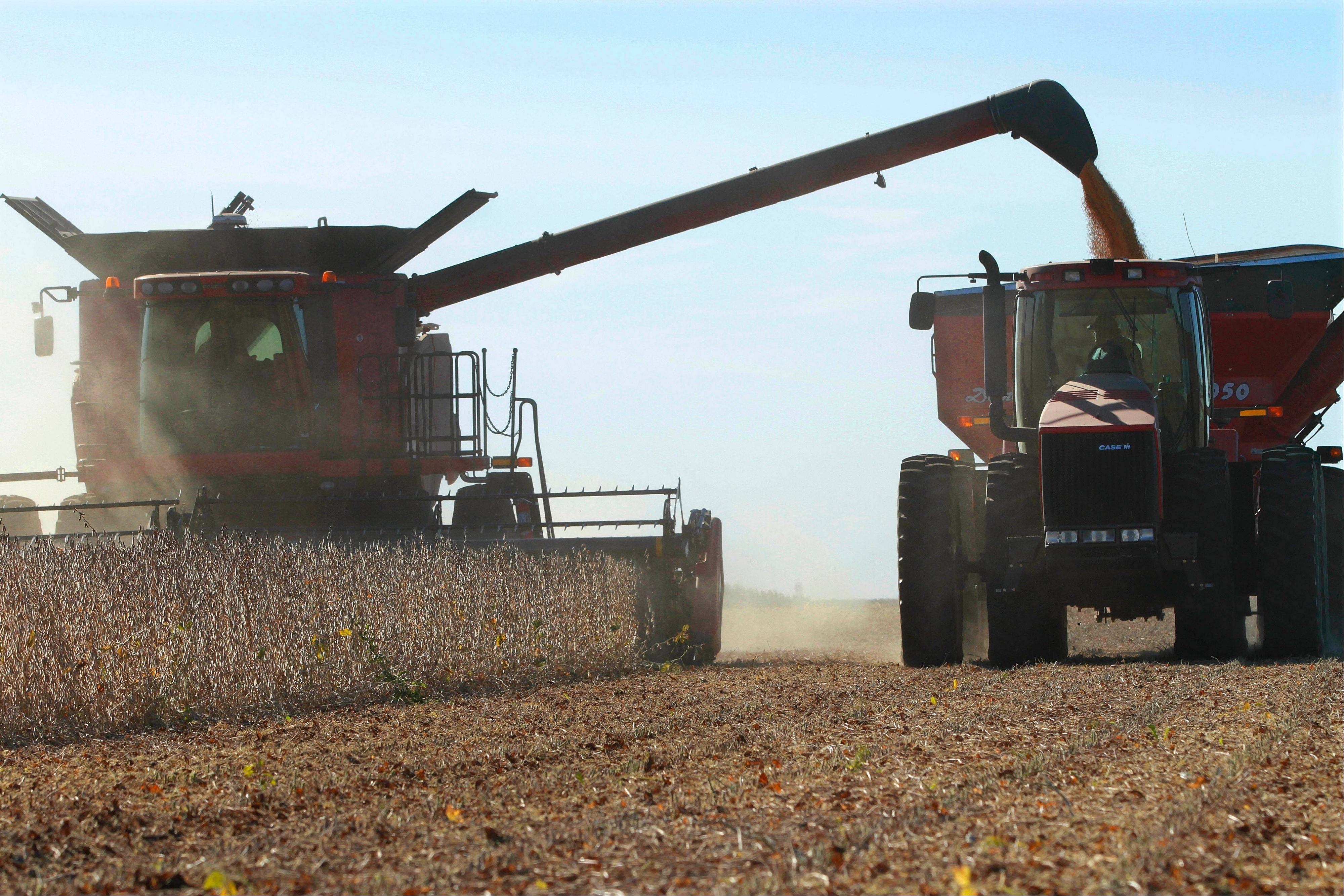 The U.S. economy grew at a sluggish 1.3 percent annual rate in the April-June quarter, held back by the severe drought that reduced farm production in the Midwest. About half of the downward revision to growth came from a decline in farm production. The estimate for crop production was slashed by $12 billion.