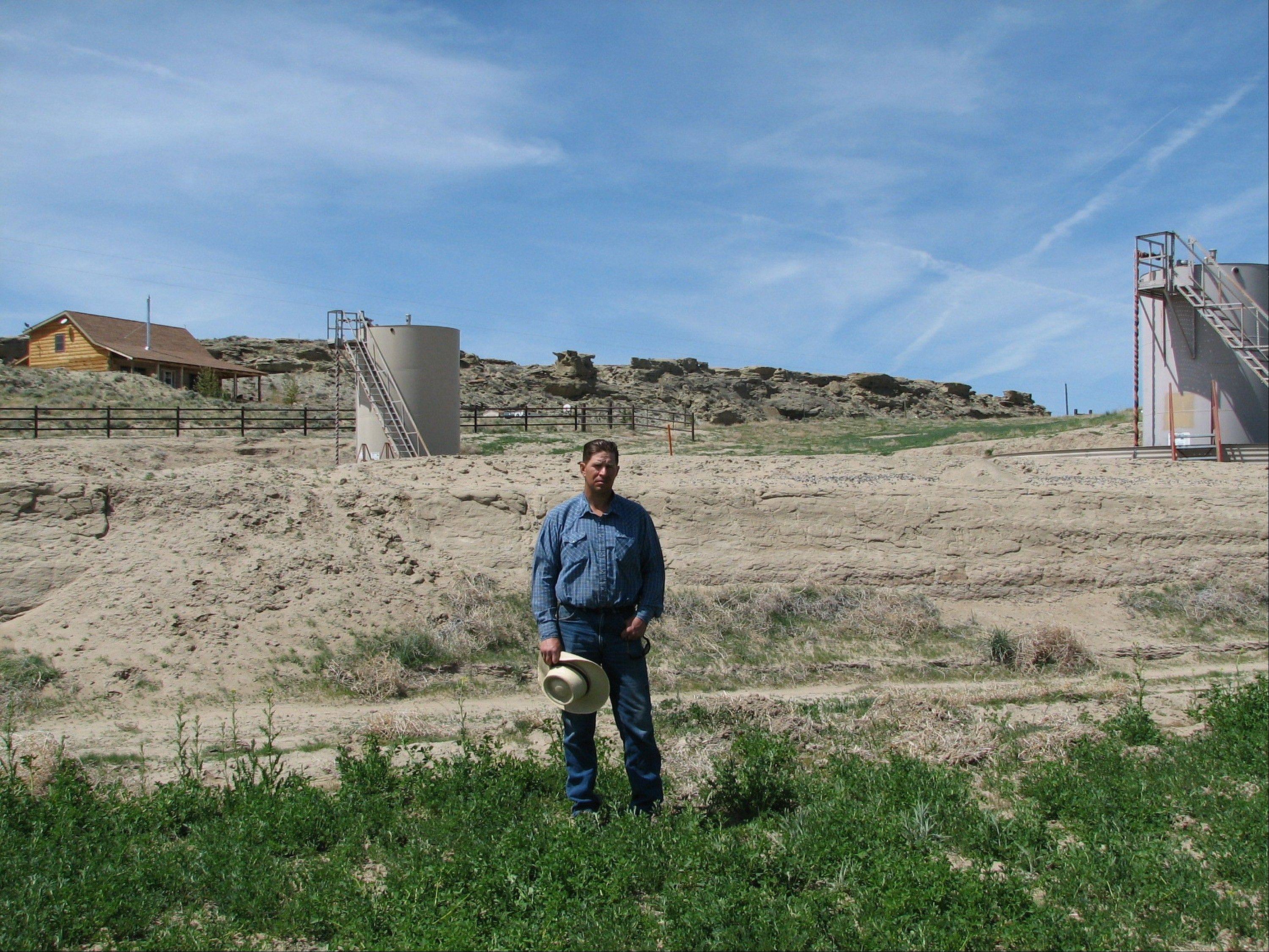"In this 2009 photo, farmer John Fenton and some of his neighbors blame hydraulic fracturing, or ""fracking,"" for fouling their well water and possibly causing health problems among residents. The U.S. Geological Survey on Wednesday released tables showing the amounts of dozens of various chemicals in the groundwater below the Pavillion area of west-central Wyoming."