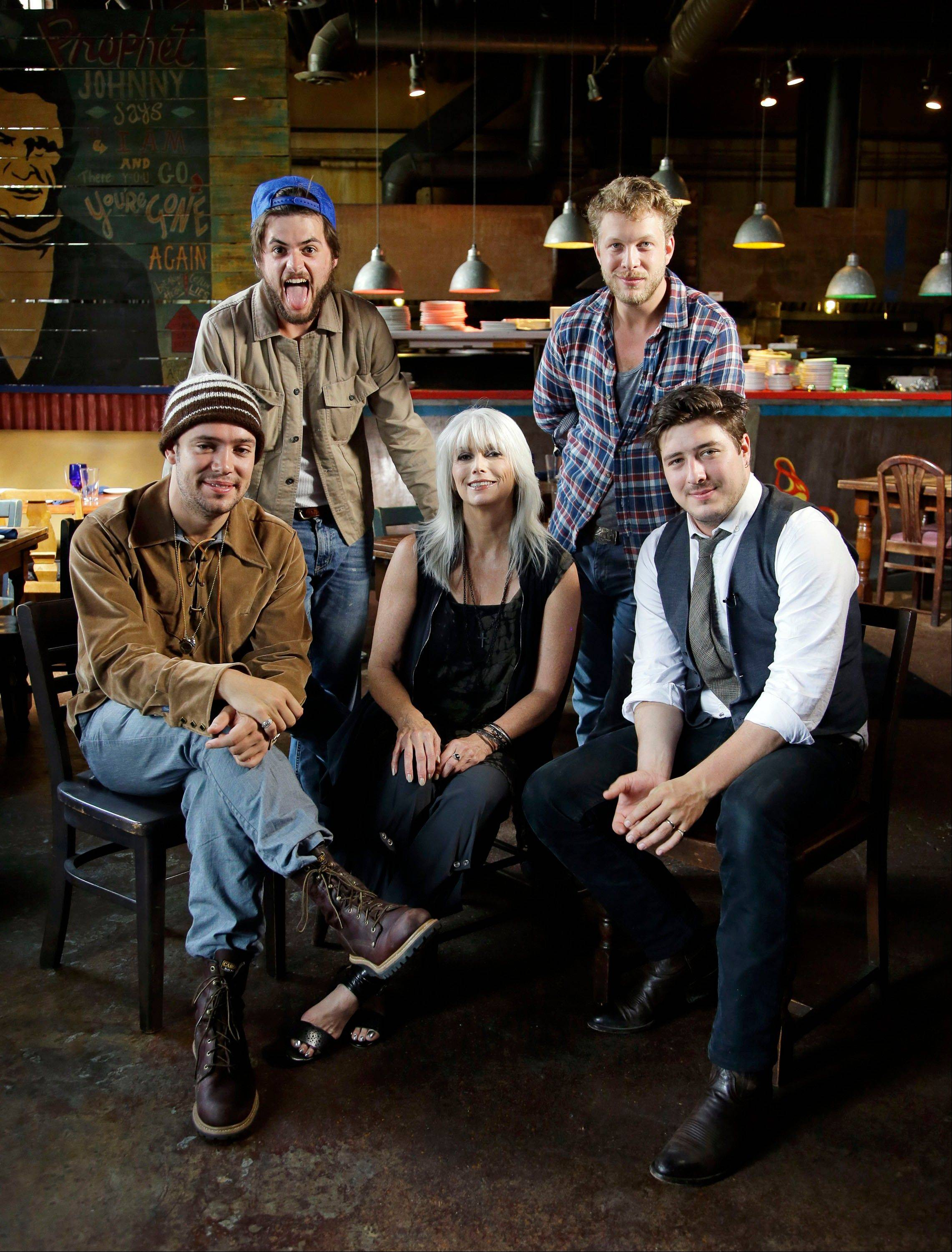 "Mumford and Sons -- Ben Lovett, left, Winston Marshall, Ted Dwane and Marcus Mumford -- join Emmylou Harris to explore their shared love of high harmony, sad songs and, yes, the oft-belittled banjo on an episode of ""CMT Crossroads"" on Thursday, Sept. 27."