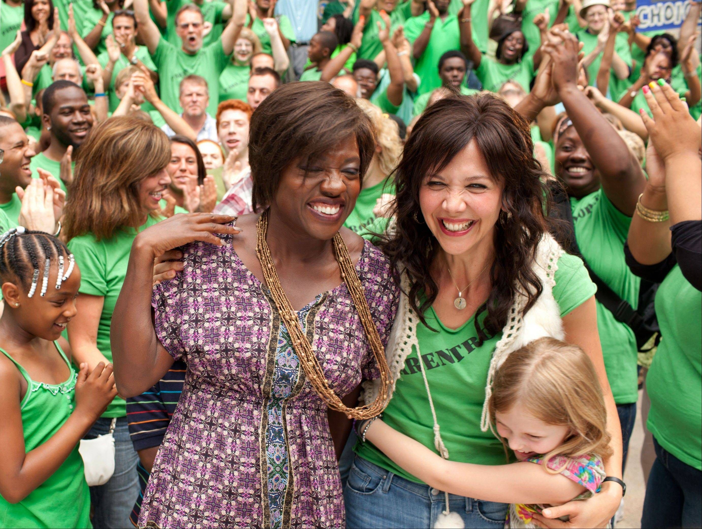 "Teacher Nona (Viola Davis) and single mom Jamie (Maggie Gyllenhaal) fight a battle for their children in the new drama ""Won't Back Down."""