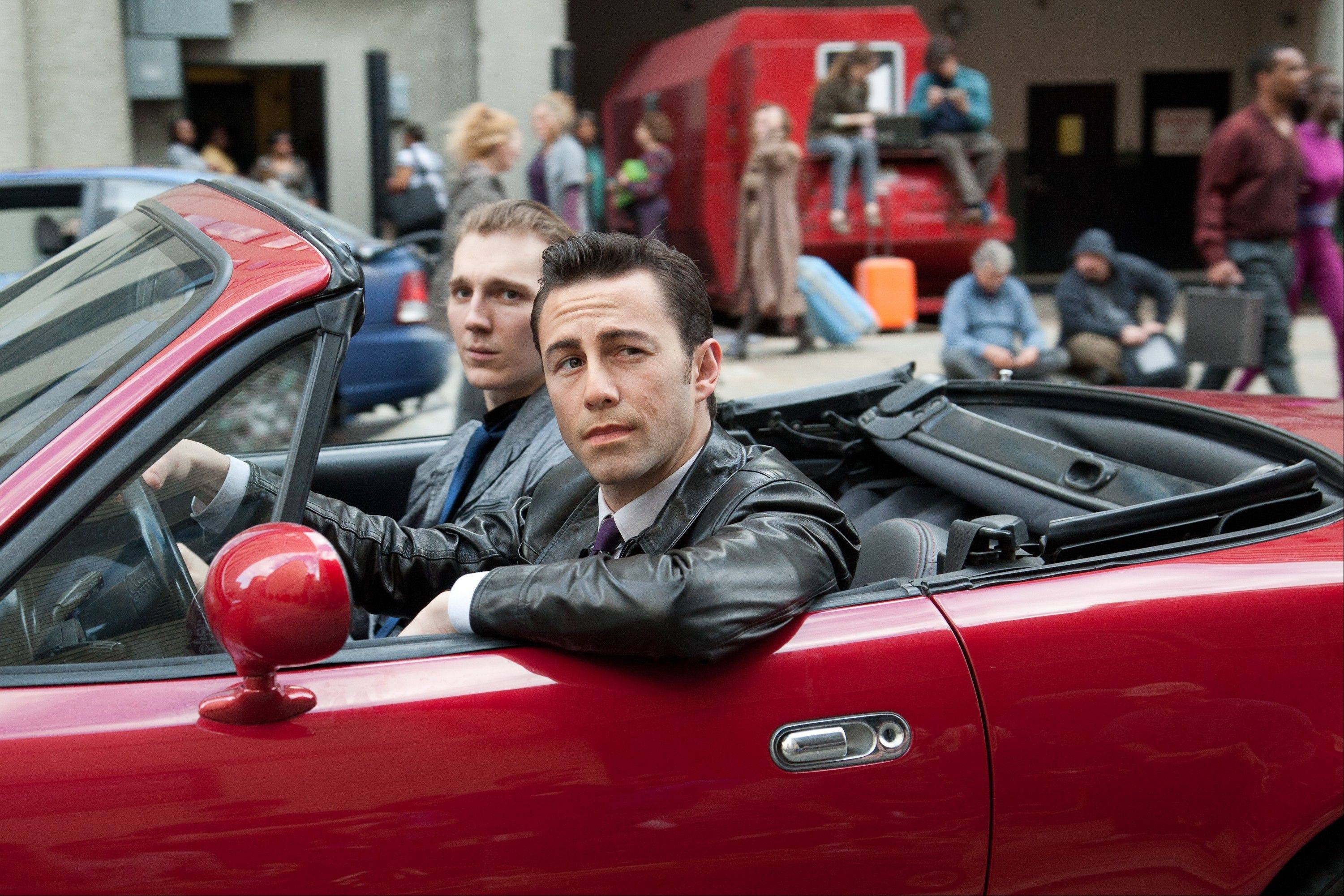 "This film image released by Sony Pictures shows Joseph Gordon-Levitt, foreground, and Paul Dano in a scene from the action thriller ""Looper."""