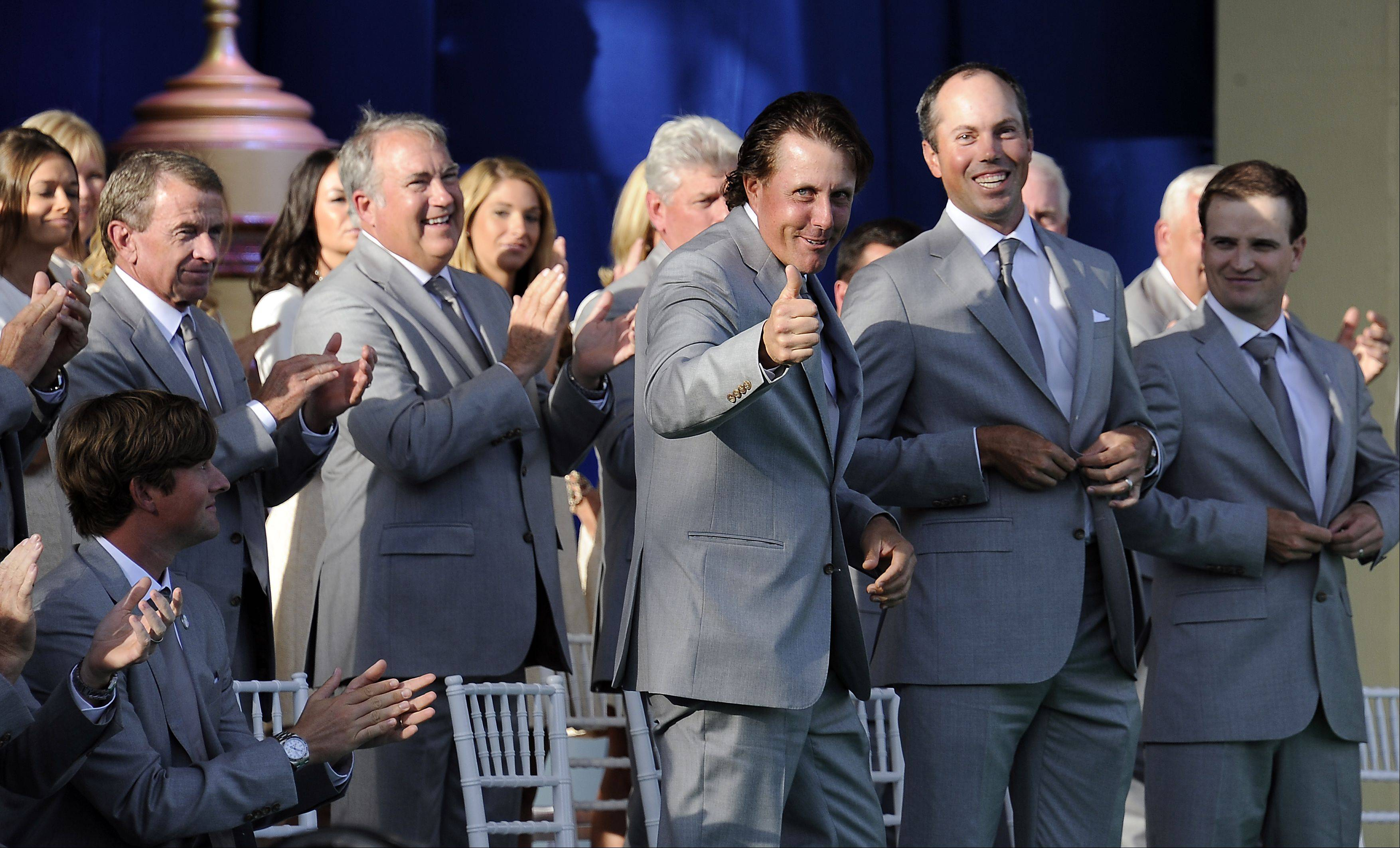 United States team member Phil Mickelson gives a thumbs-up to the fans during the opening ceremonies of Ryder Cup at Medinah on Thursday.