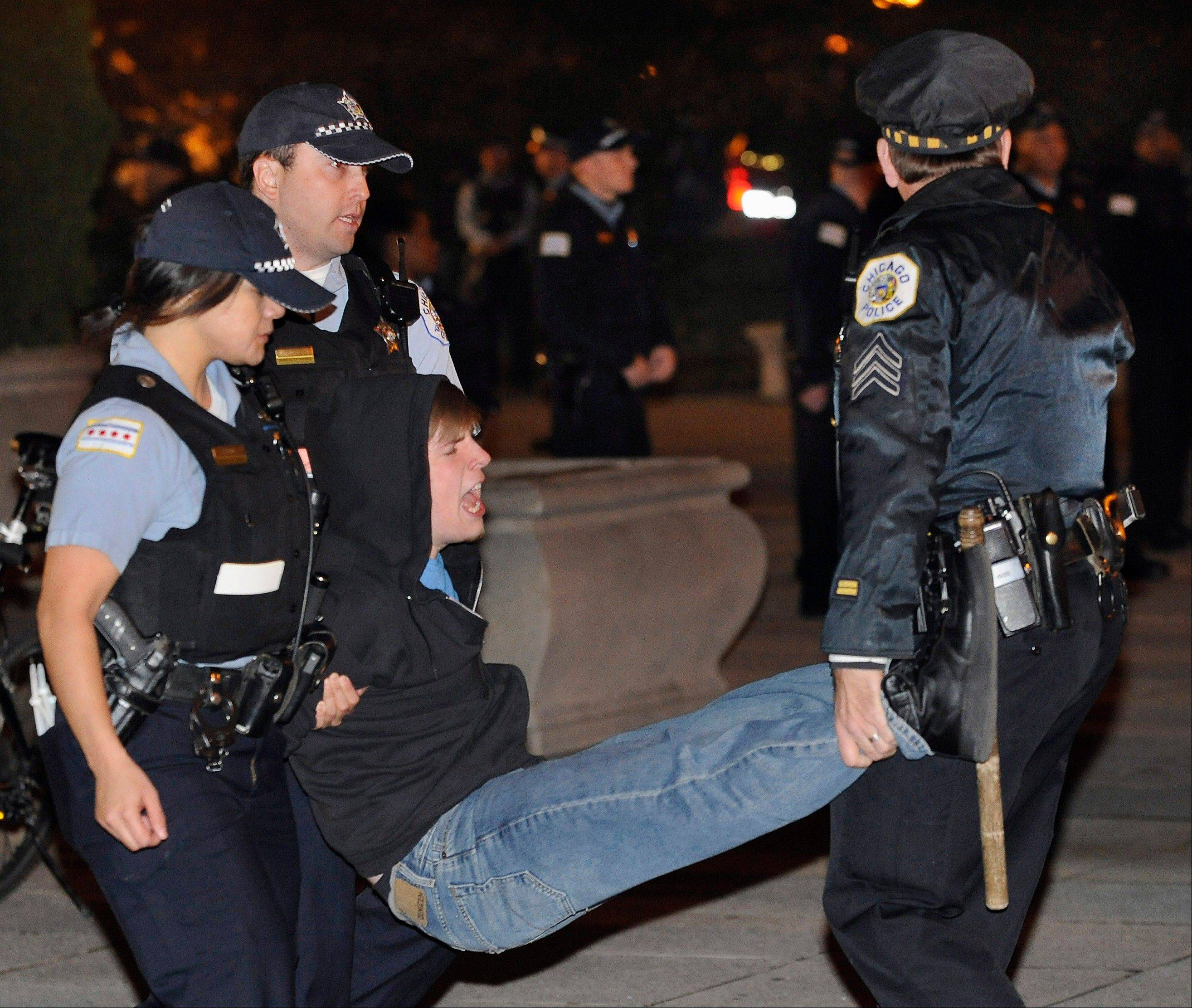 A protester gets arrested during an Occupy Chicago march and protest Oct. 23, 2011, in Grant Park in Chicago. More than 90 arrests came after members of the group refused to take down tents and leave Grant Park when it closed at 11 p.m.
