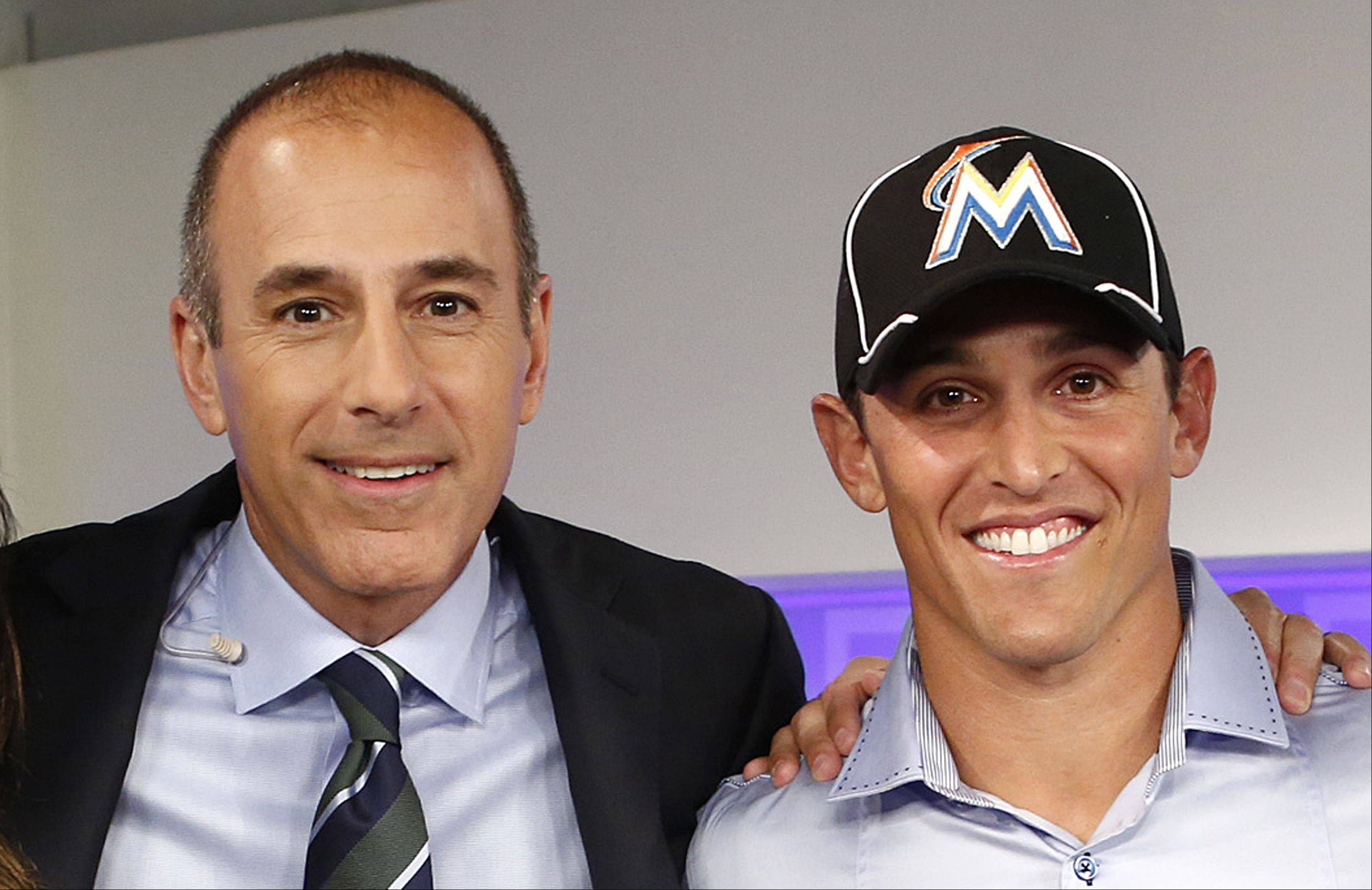 """Today"" show host Matt Lauer, left, poses with Adam Greenberg Thursday, after the Miami Marlins said they signed Greenberg to a one-day contract and will play him Tuesday against the New York Mets."