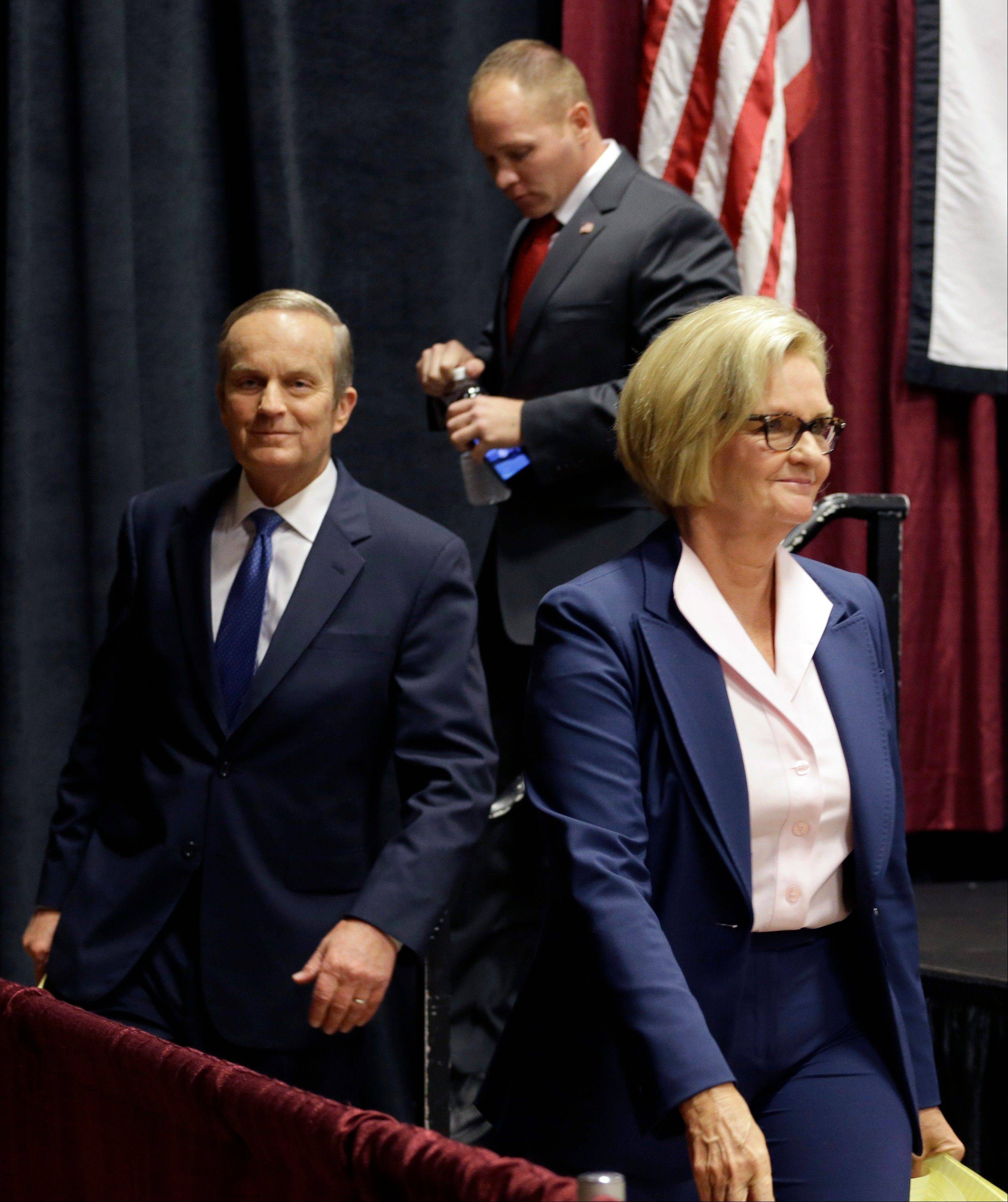 Democratic Sen. Claire McCaskill, right, walks off the stage with challengers Republican Todd Akin, left, and Libertarian Jonathan Dine following their debate in the Missouri Senate race last Friday.