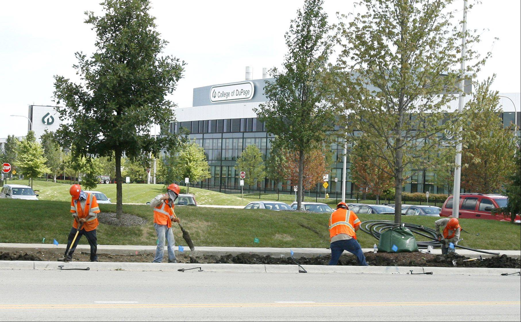 Members of the College of DuPage faculty senate say the administration is spending too much money on landscaping for the 273-acre Glen Ellyn campus, but COD President Robert Breuder says beautification efforts have led to enrollment growth.