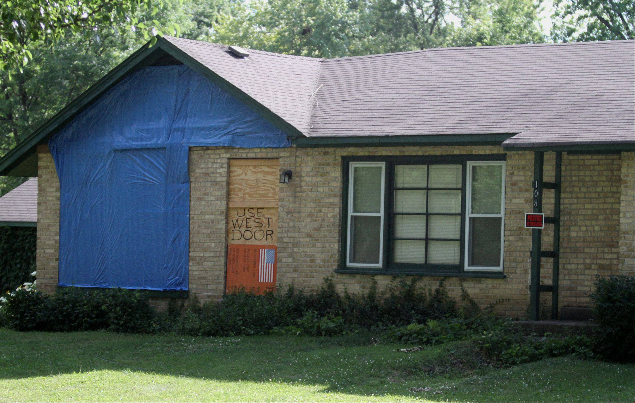 The village of Palatine is in an ongoing legal battle over violations at former Palatine Councilman Warren Kostka's home, pictured here in June. On Thursday. a judge told Kostka he needs to either tear down the structure or begin extensive repairs.