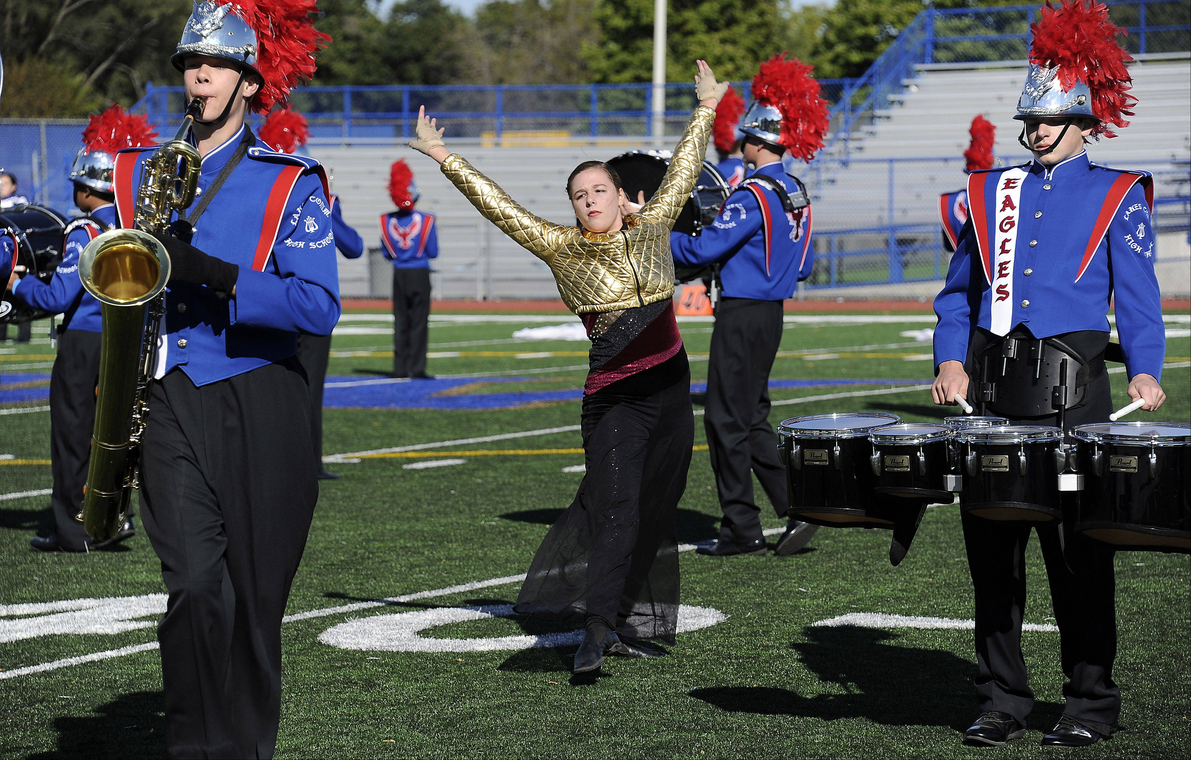"Lakes Community color guard member Megan Lemke dances her way around the band during ""Zeus's Presentation."""