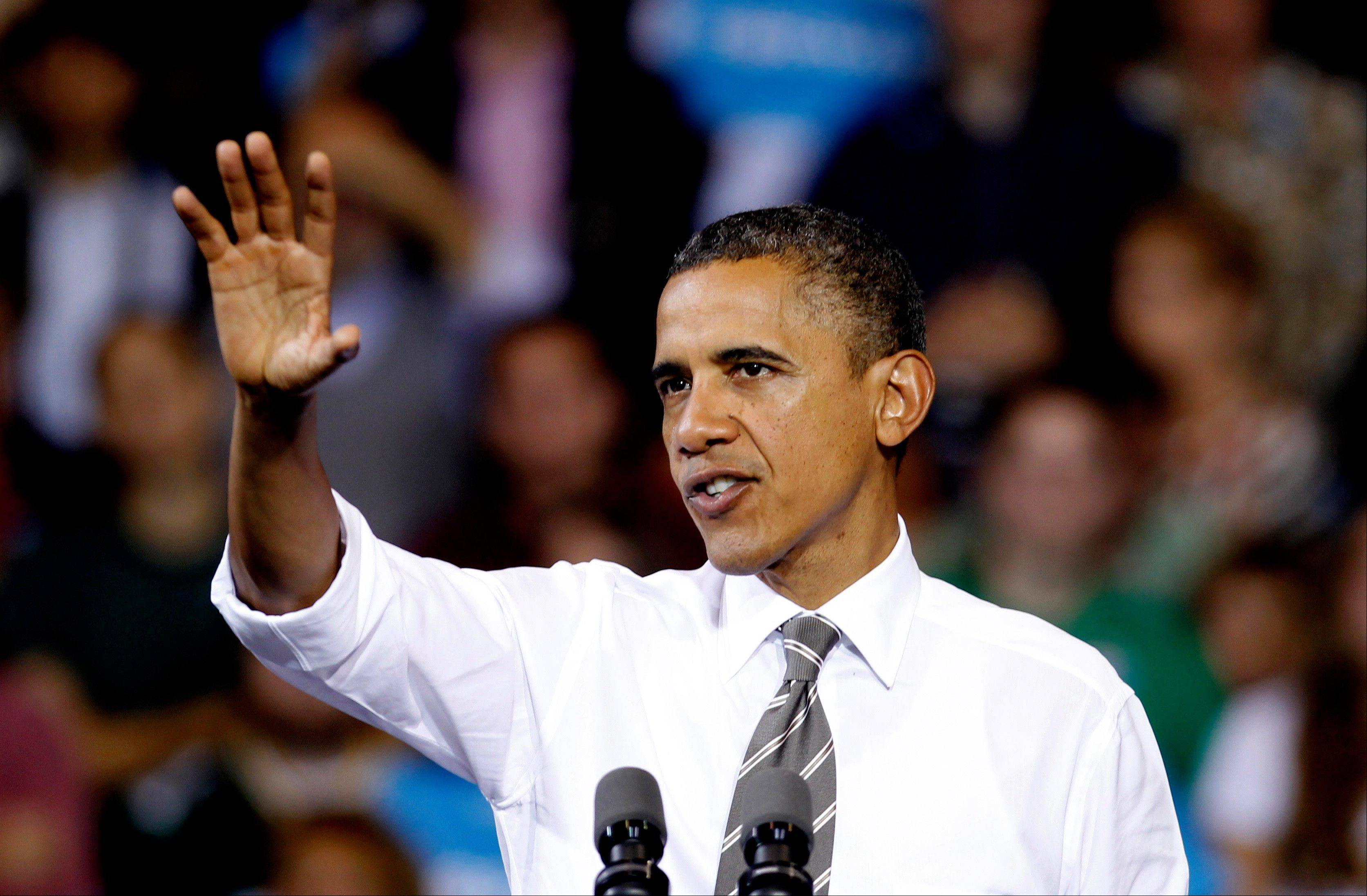 President Barack Obama speaks at a campaign event at The Memorial Athletic and Convocation Center at Kent State University Wednesday, Sept. 26, 2012, in Kent, Ohio.