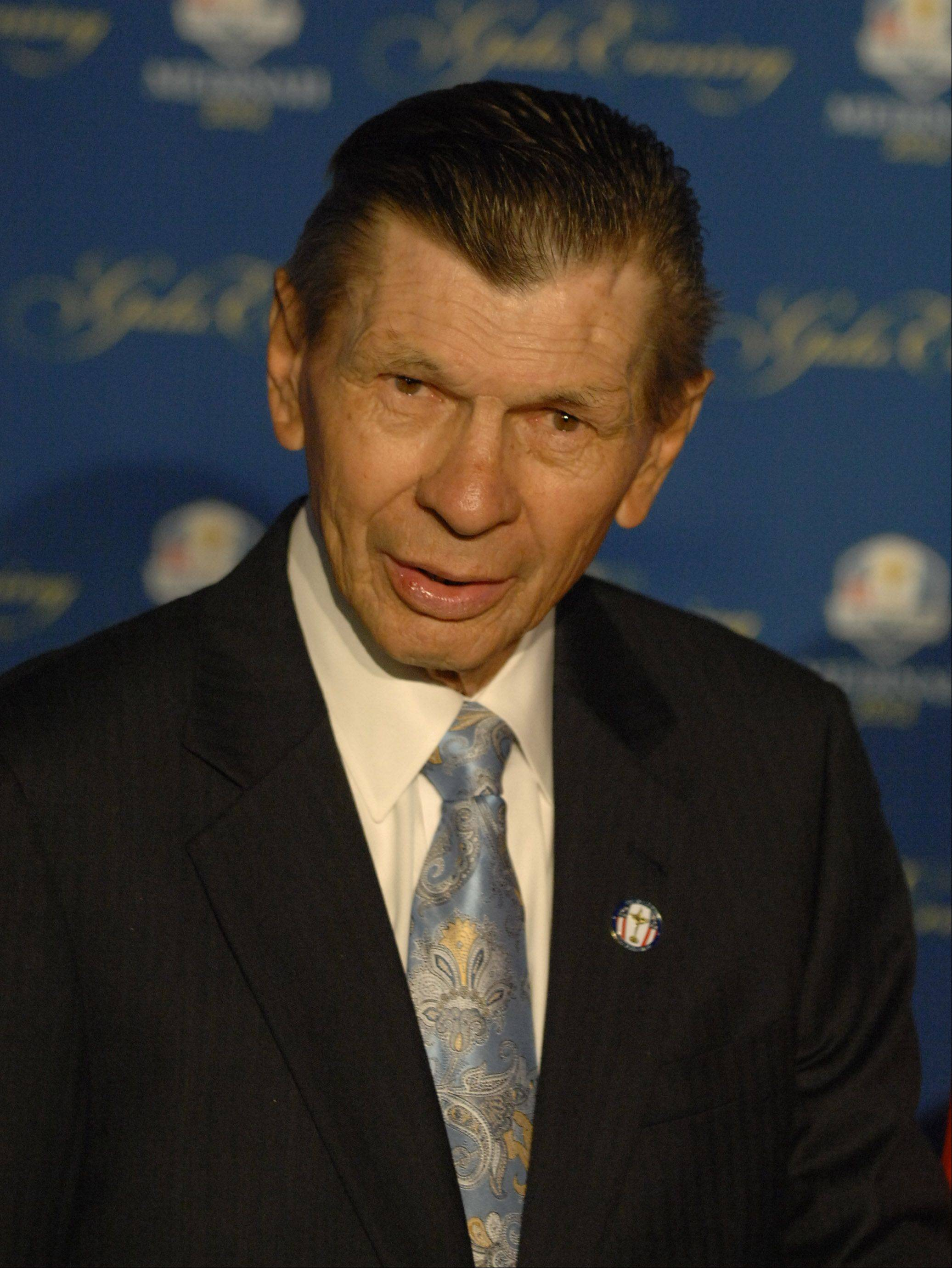 Former Chicago Blackhawks Stan Mikita walks the 39th Ryder Cup Gala red carpet at the Akoo Theatre in Rosemont Wednesday.
