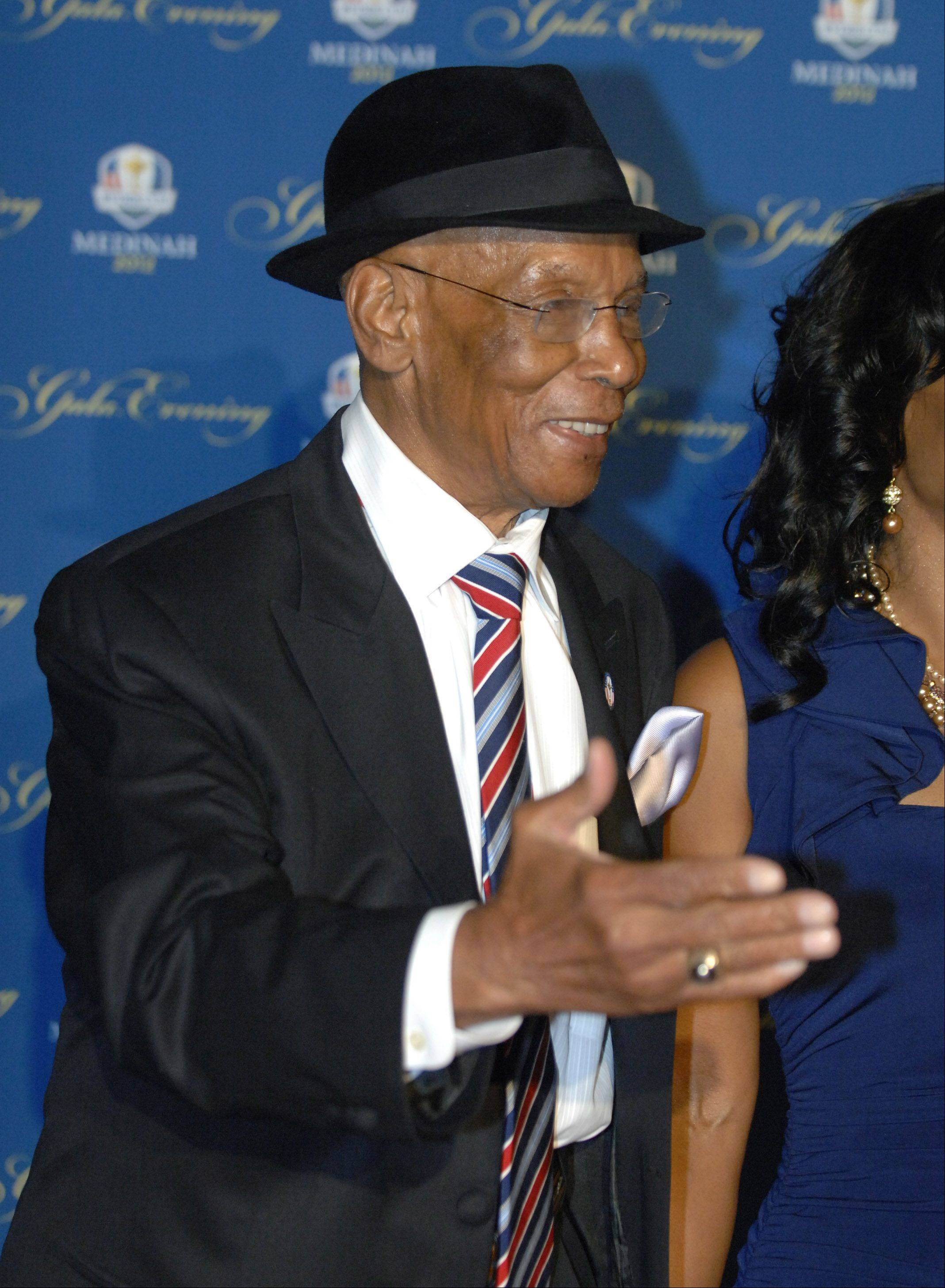 "Former Chicago Cub Ernie Banks walks the 39th Ryder Cup Gala red carpet at the Akoo Theatre in Rosemont Wednesday. When asked about the Ryder Cup, Banks jokingly replied ""What about my Cubs?"""