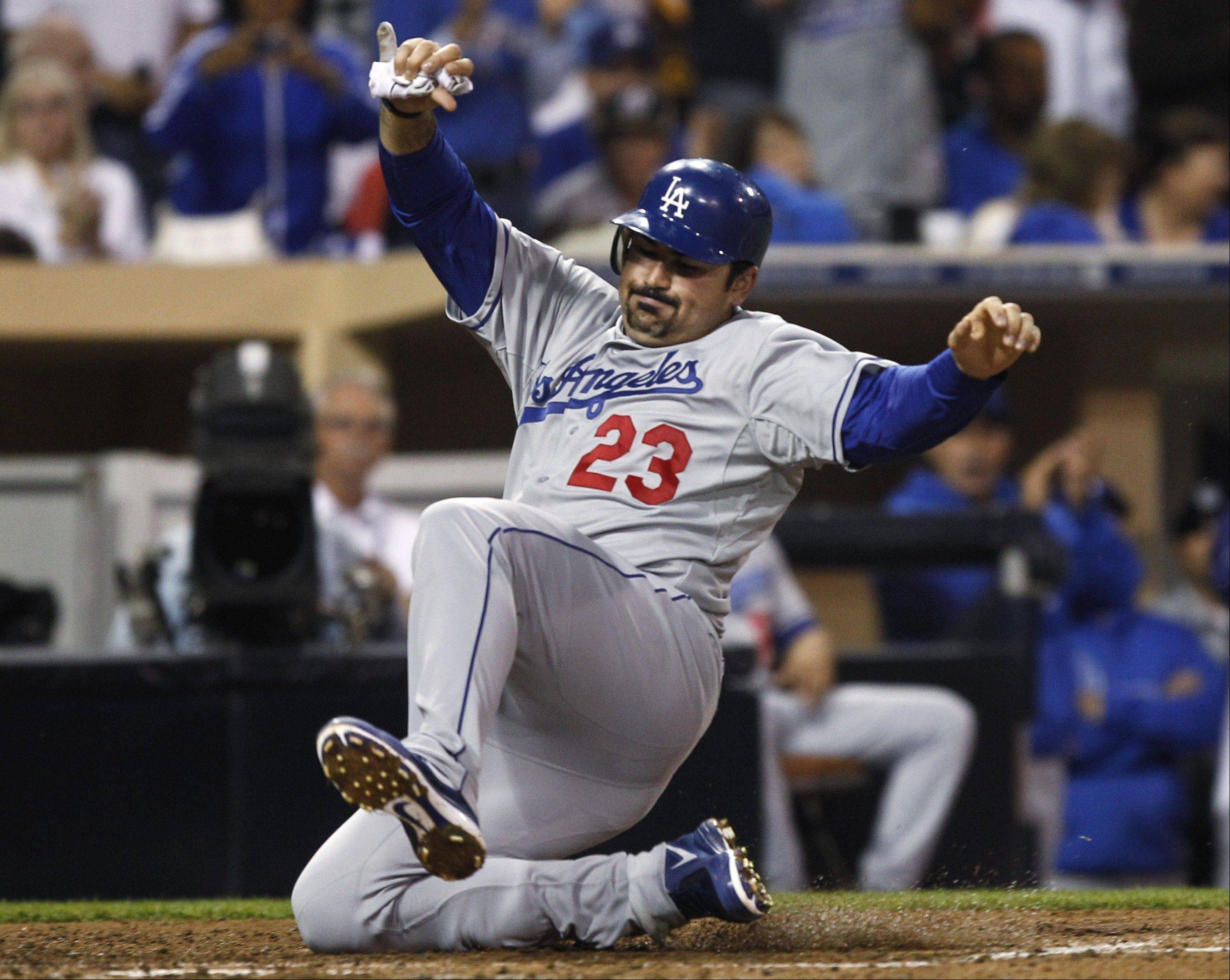 The Dodgers' Adrian Gonzalez scores on a single by A.J. Ellis during the fourth inning Thursday in San Diego.