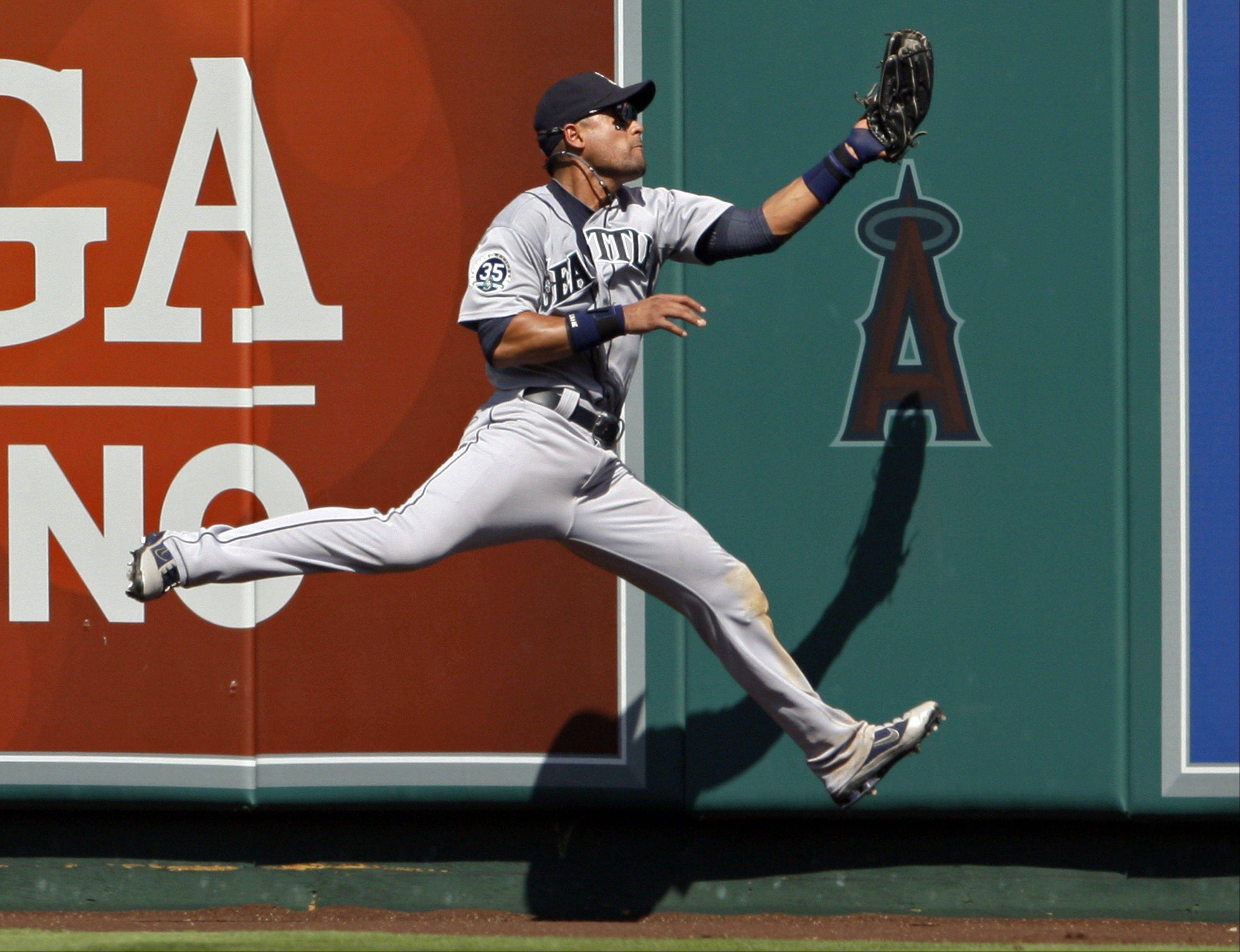 Seattle Mariners center fielder Franklin Gutierrez catches a fly ball hit by the Angels' Mike Trout in the fifth inning Thursday in Anaheim, Calif.