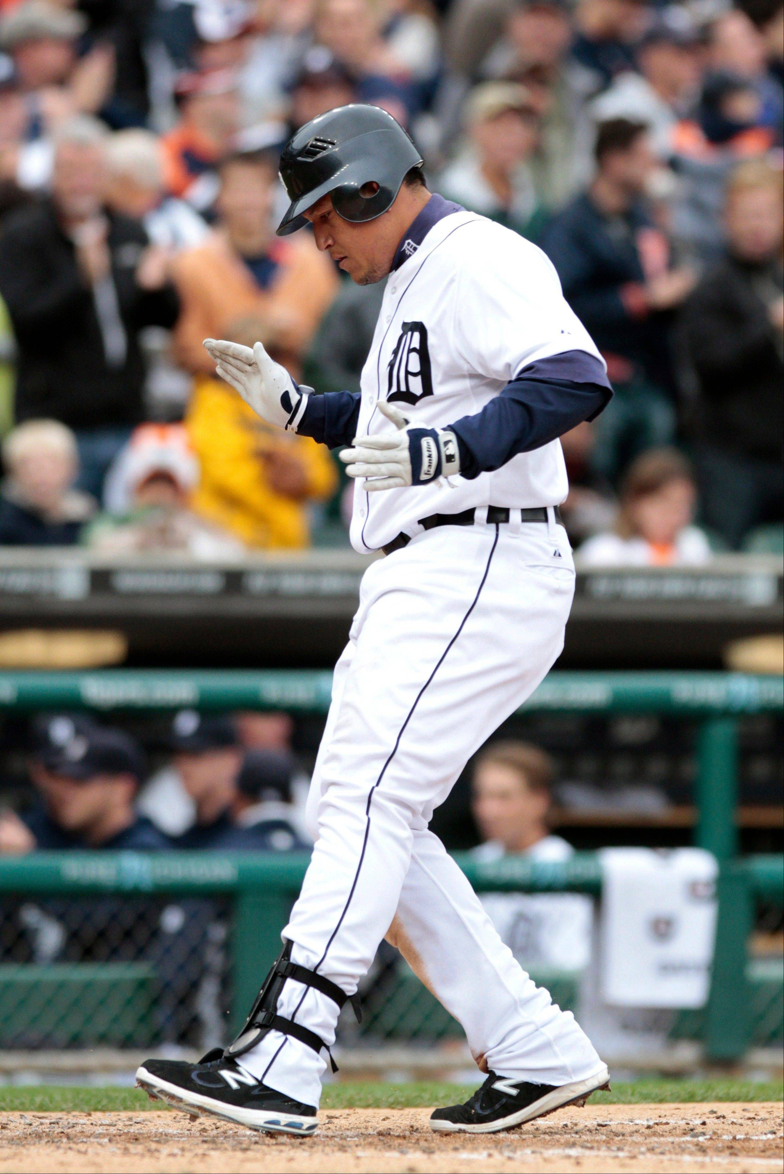 The Tigers' Miguel Cabrera crosses home plate after hitting a solo hom