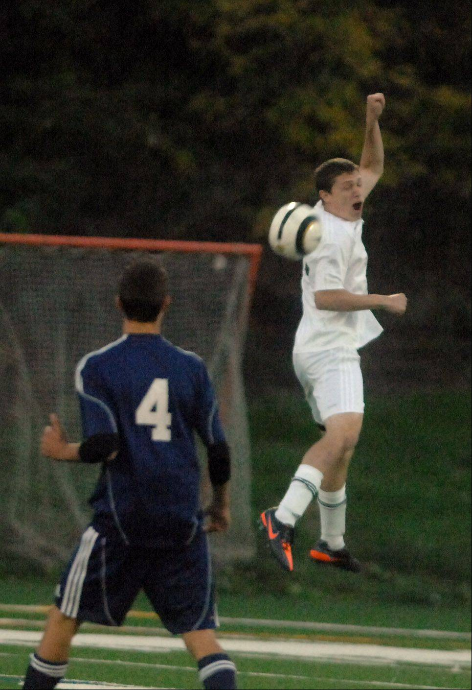 Ben Ruby of Glenbard West goes up for a ball during the Bartlett at Glenbard West boys soccer game Thursday.