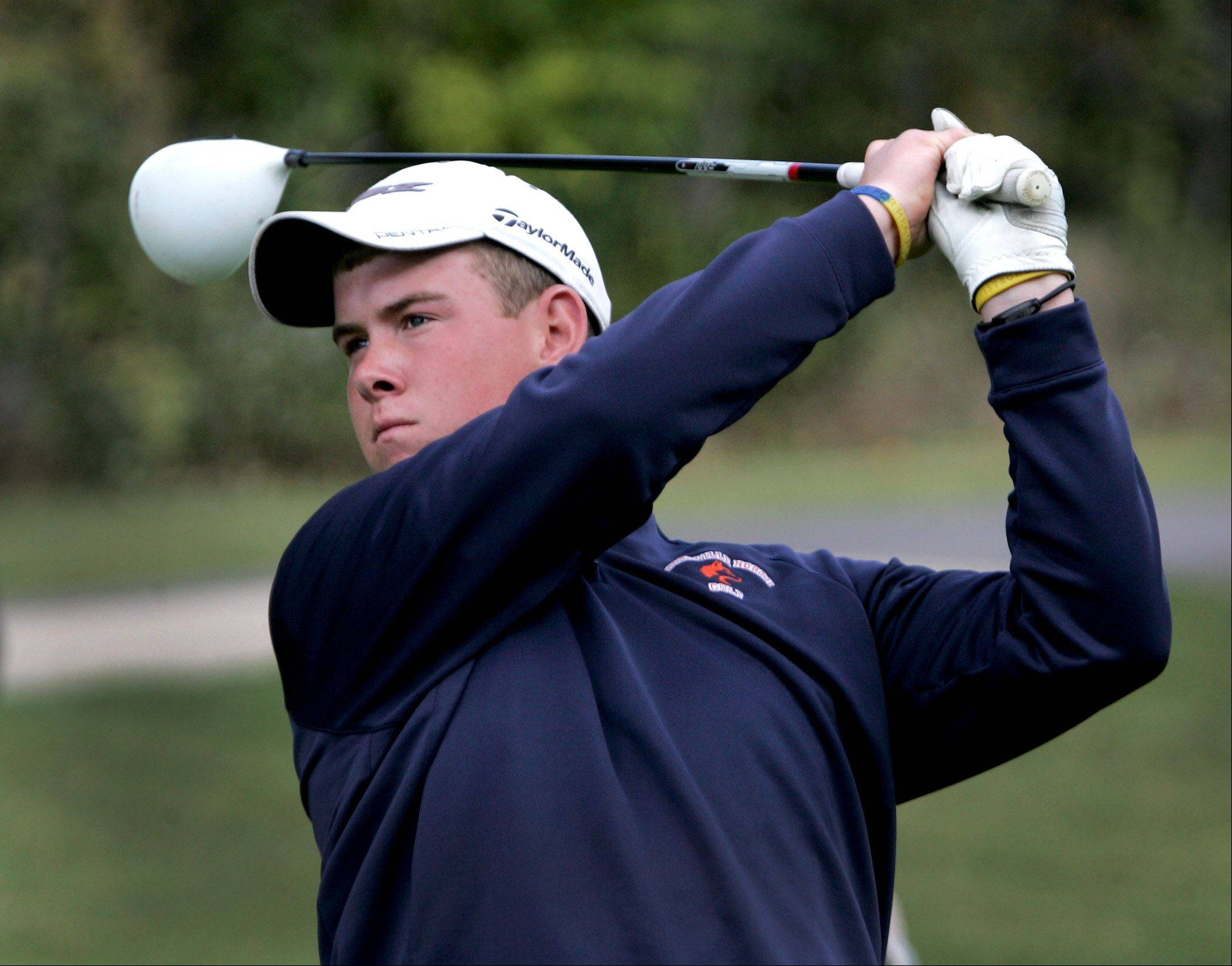 Raymond Knoll of Naperville North watches his drive from the 6th tee during DuPage Valley Conference boys golf at Bartlett Hills Golf course on Thursday.